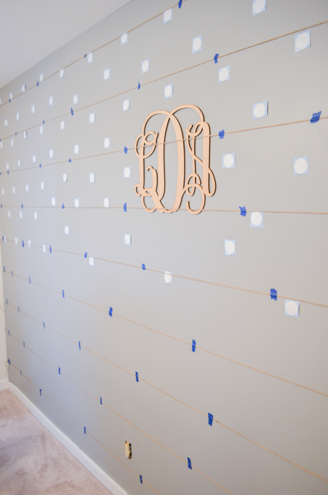 how to make a polka dot accent wall - must-have tips for a diy polka dot nursery wall | bylaurenm.com