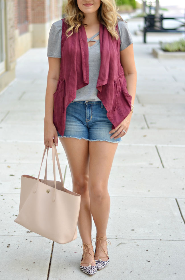 cute ways to wear shorts for fall - draped vest with shorts and lace up flats | www.fizzandfrosting.com