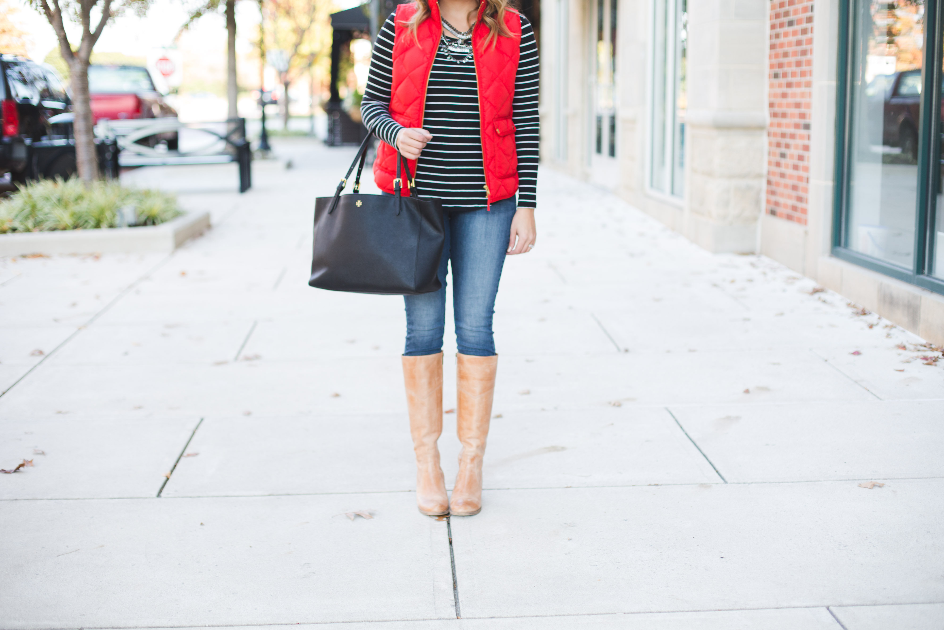 casual holiday outfit - red puffer vest, stripe tee, tan boots | www.bylaurenm.com