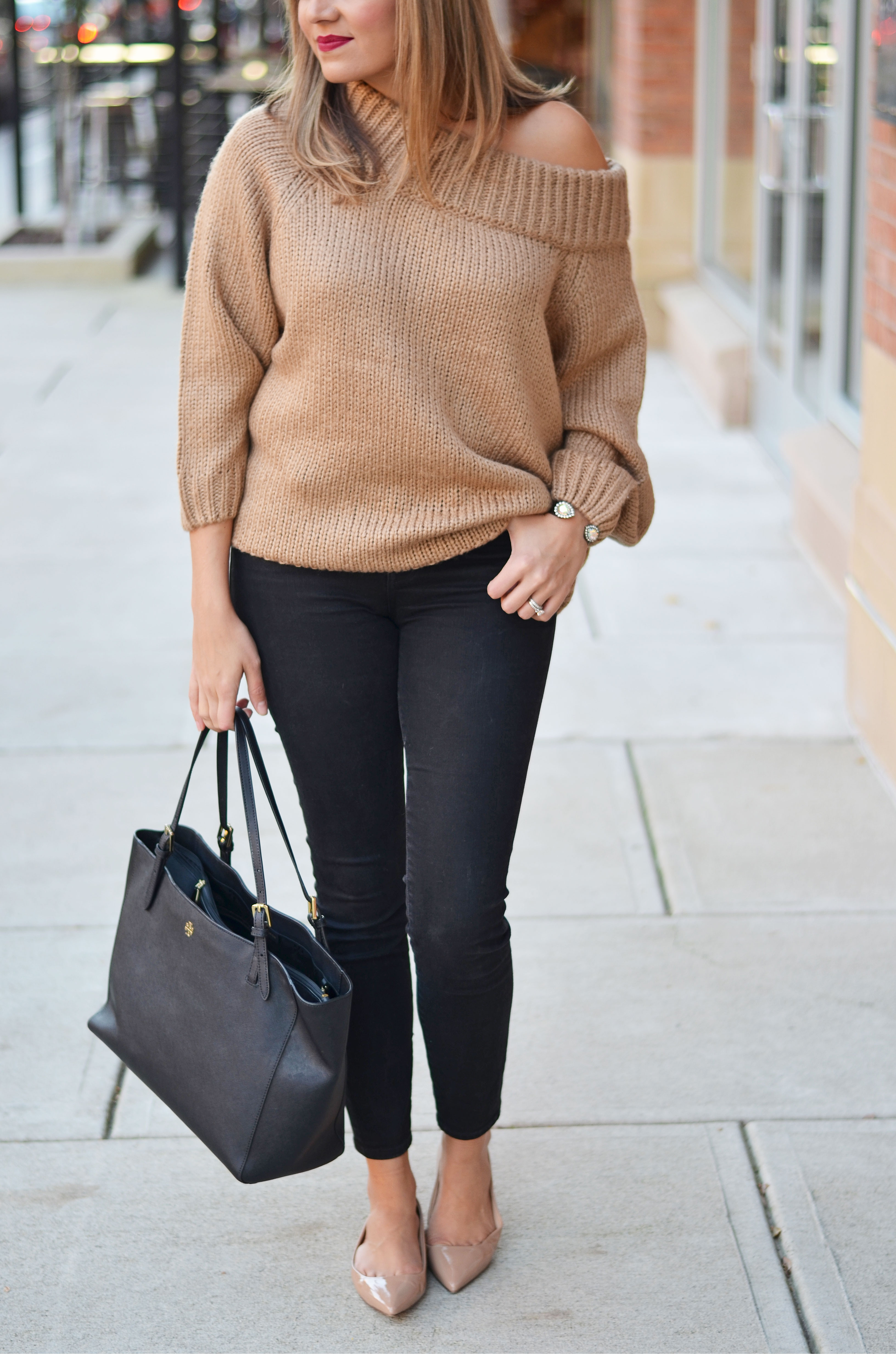 chunky camel sweater outfit - camel off shoulder sweater with black skinny jeans, nude patent flats, Tory Burch tote | www.bylaurenm.com