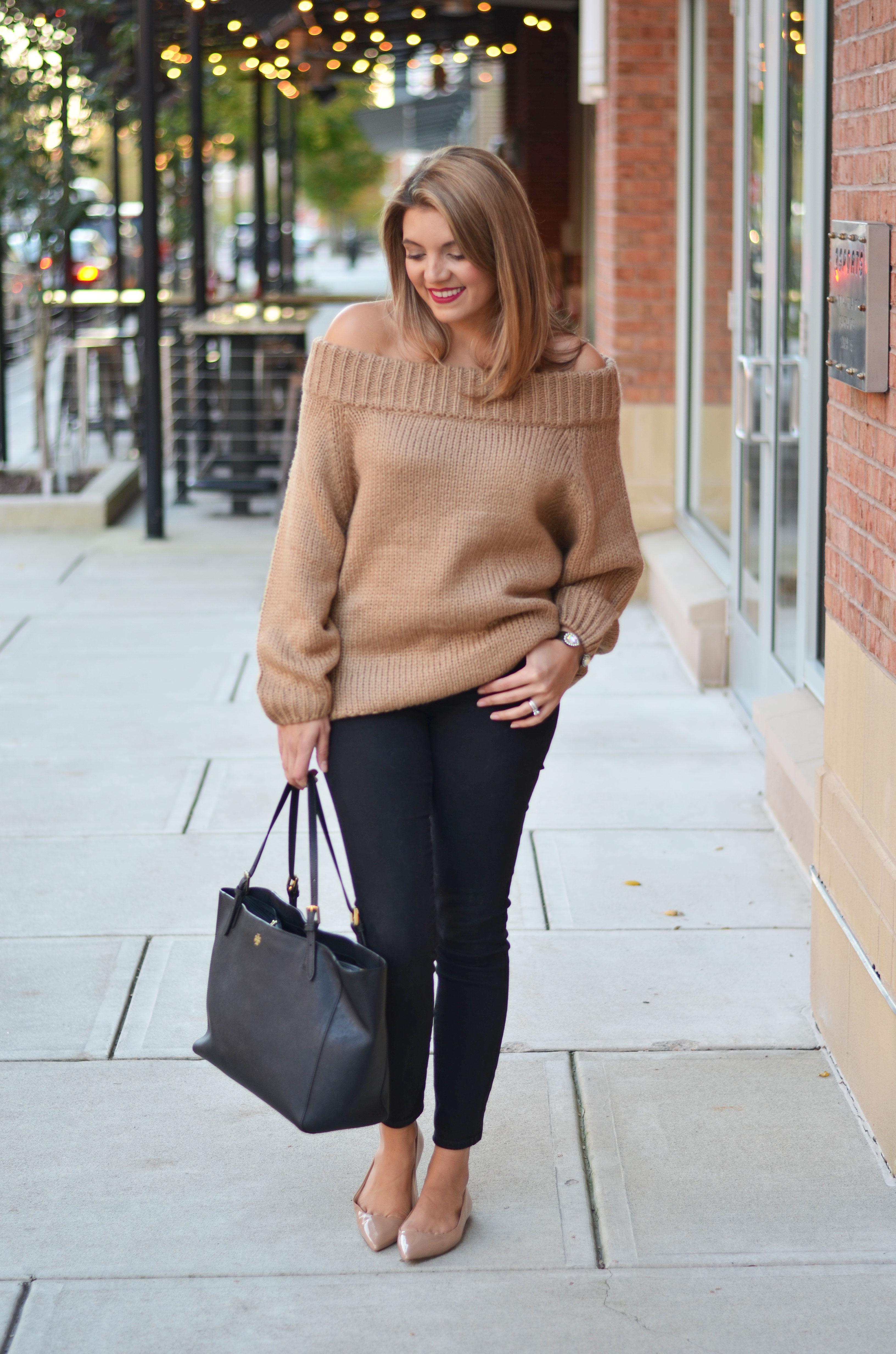 tan off shoulder sweater outfit - camel sweater with black jeans, nude patent flats, and tory burch tote | www.bylauren.com