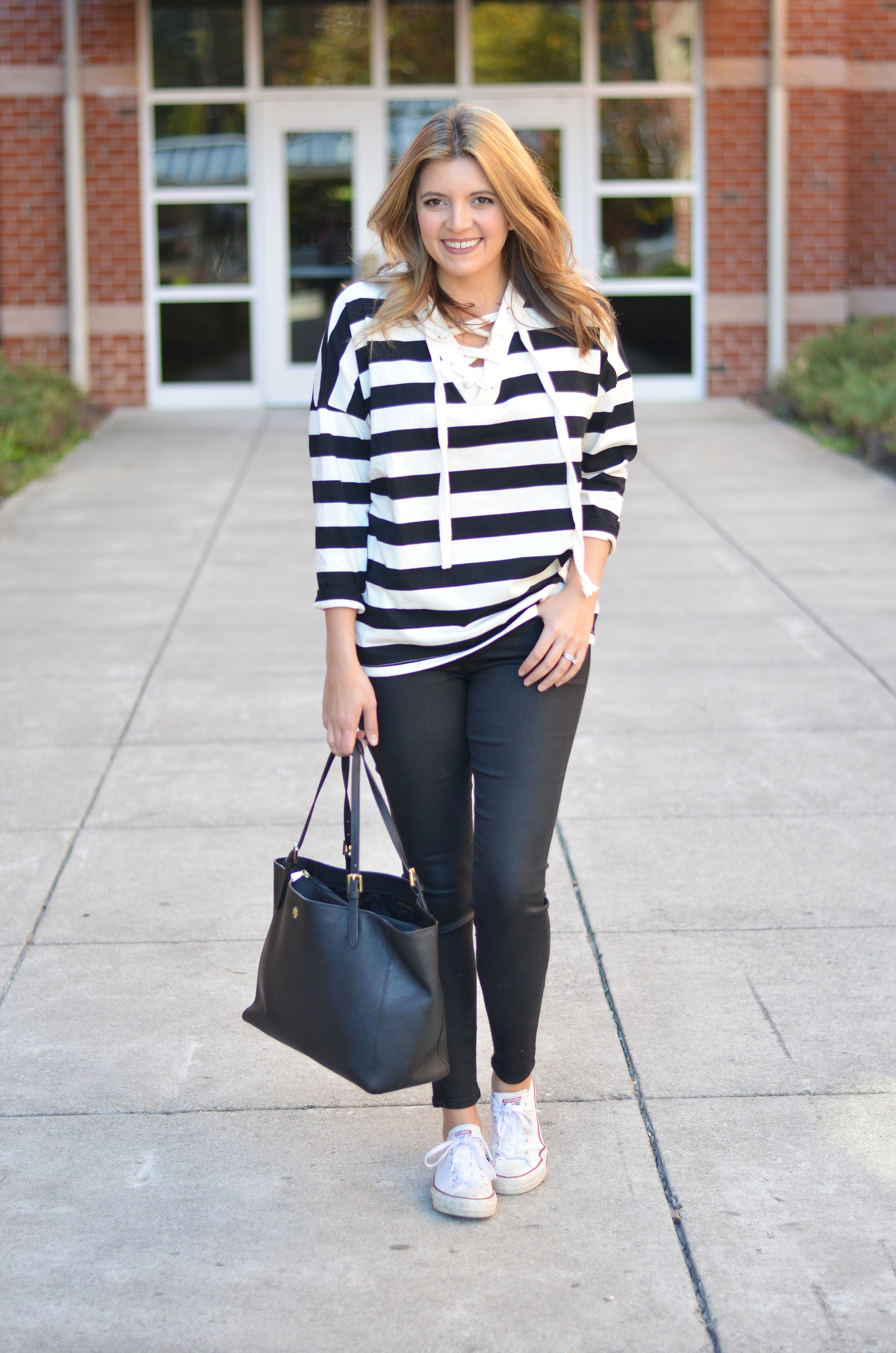stripe lace-up top with black coated jeans and white converse | www.bylaurenm.com