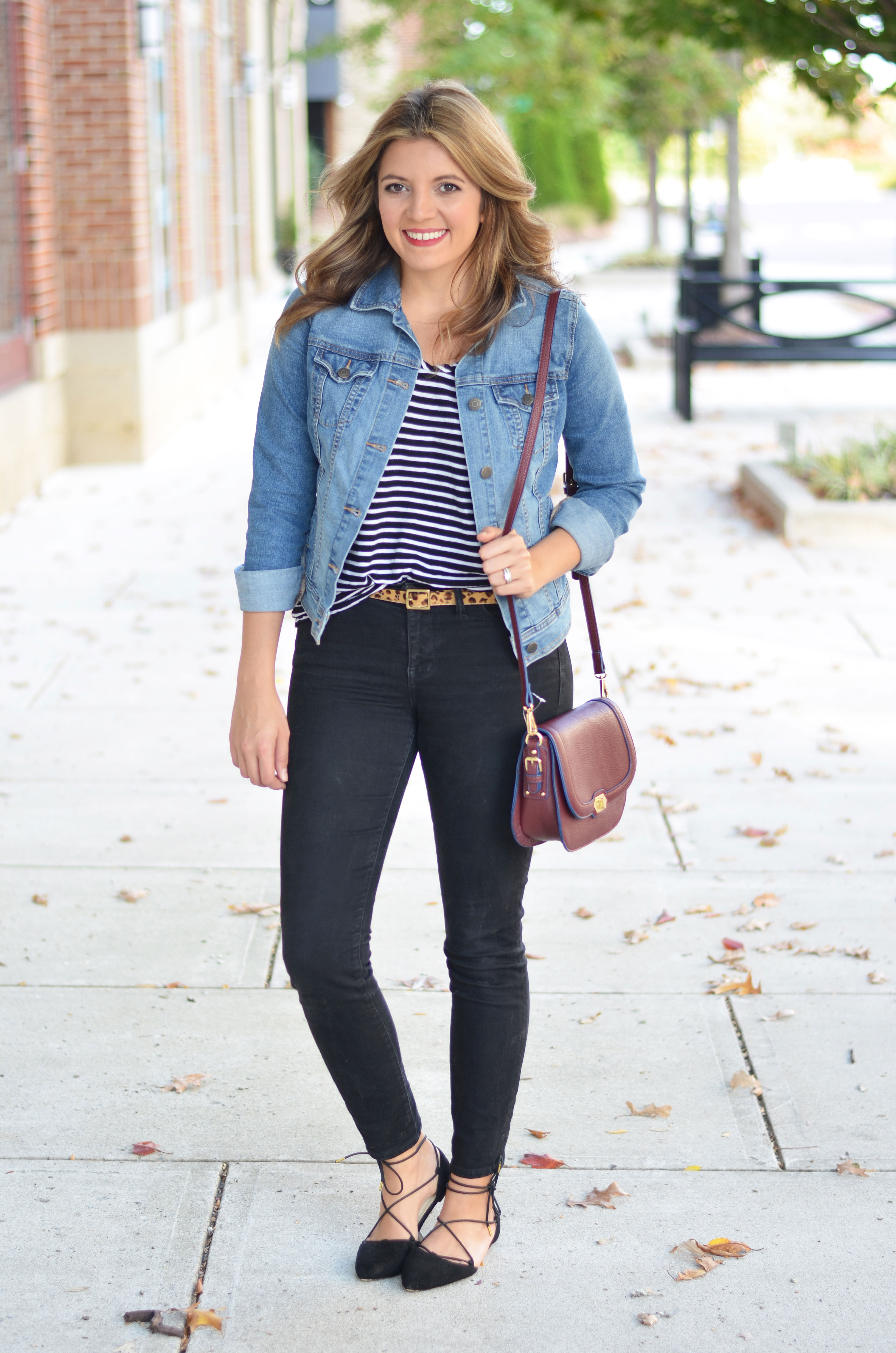 stripes and leopard print outfit - black jeans, stripe tee, leopard print belt, and denim jacket | www.bylaurenm.com