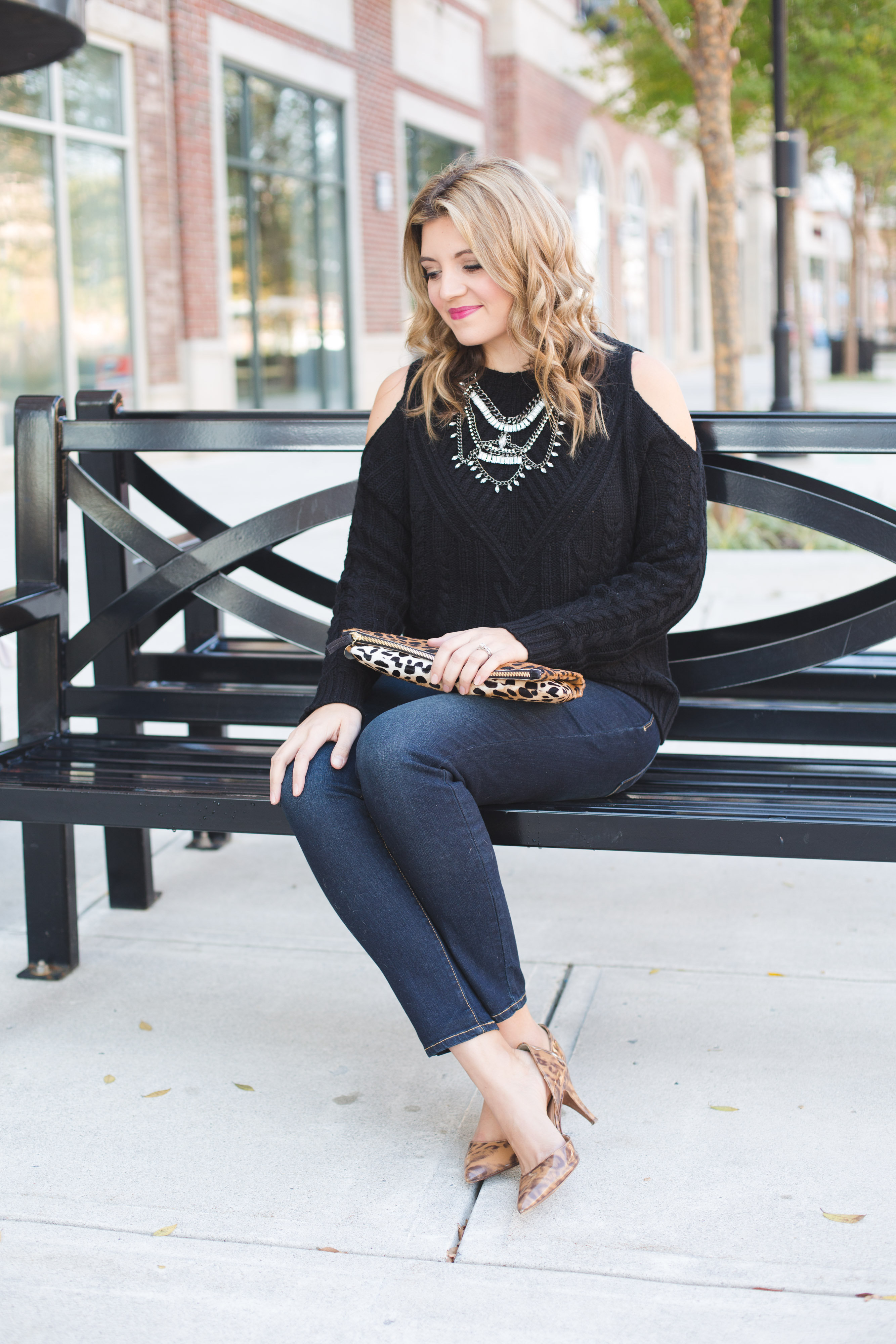 jeans holiday party outfit - dark wash skinny jeans with heels, black sweater, crystal statement necklace | www.bylaurenm.com