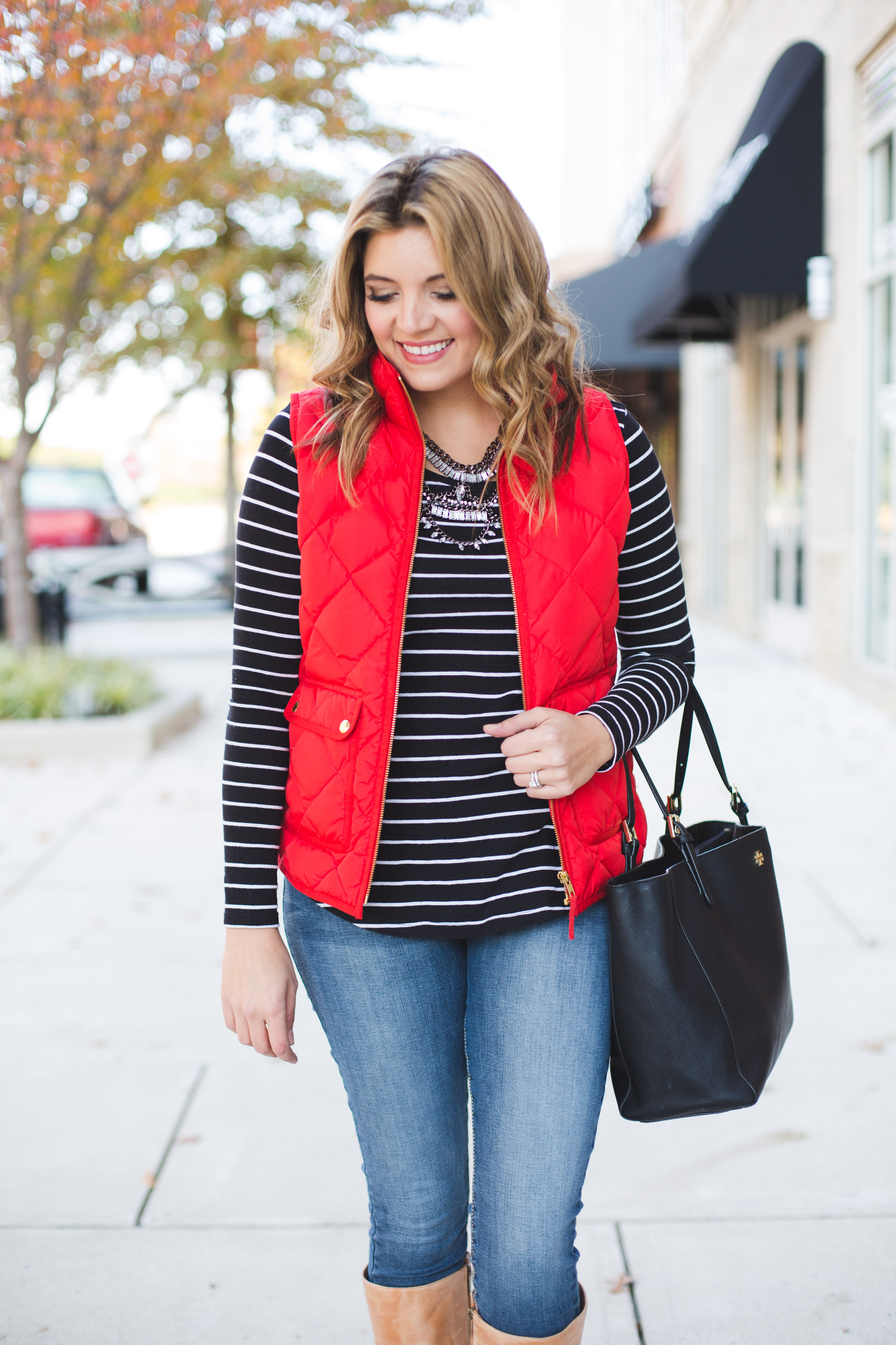 red puffer vest with stripe tee and a statement necklace | www.bylaurenm.com