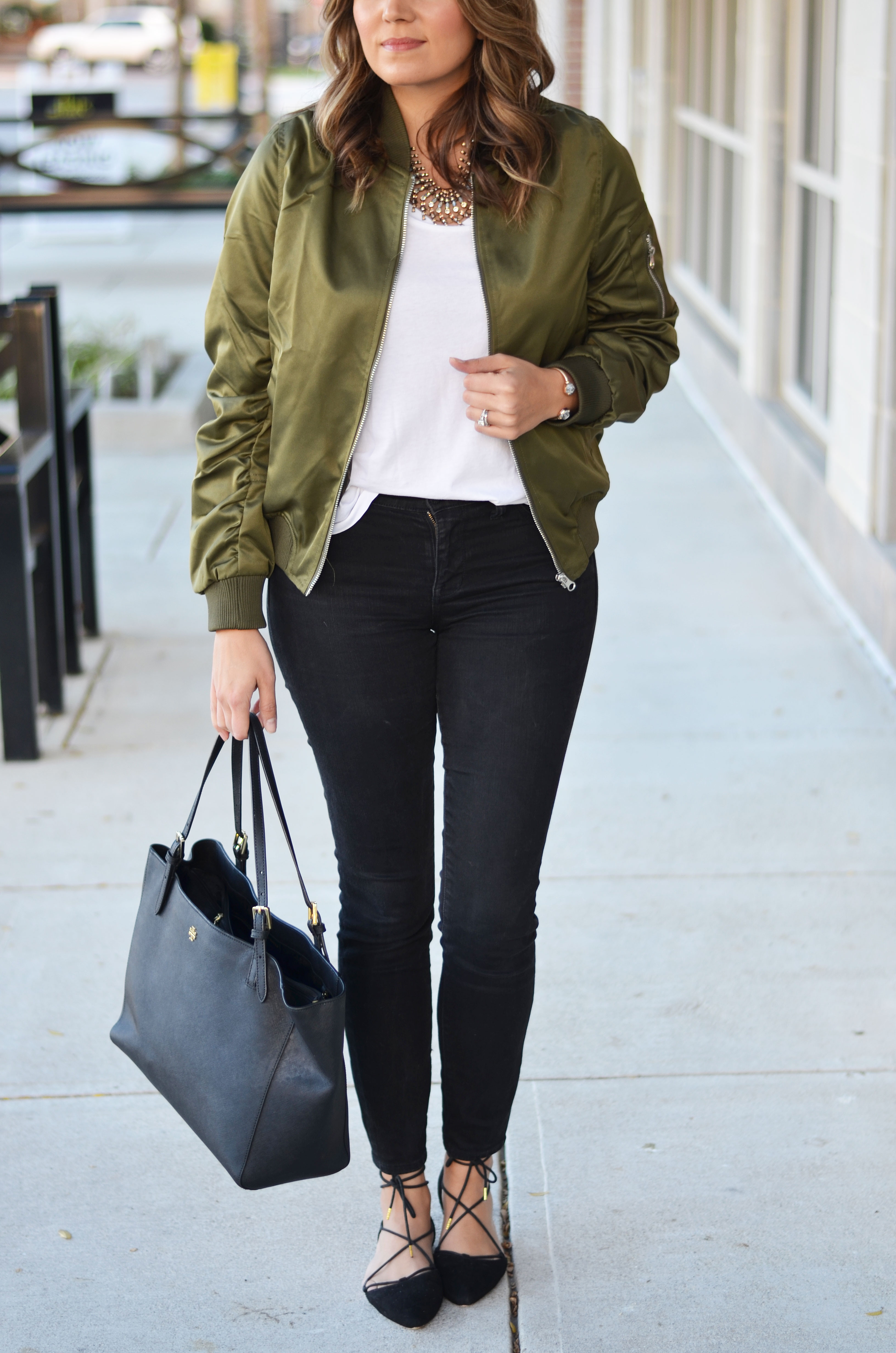 satin bomber jacket outfit idea - green bomber jacket with white tee and black skinny jeans | www.bylaurenm.com