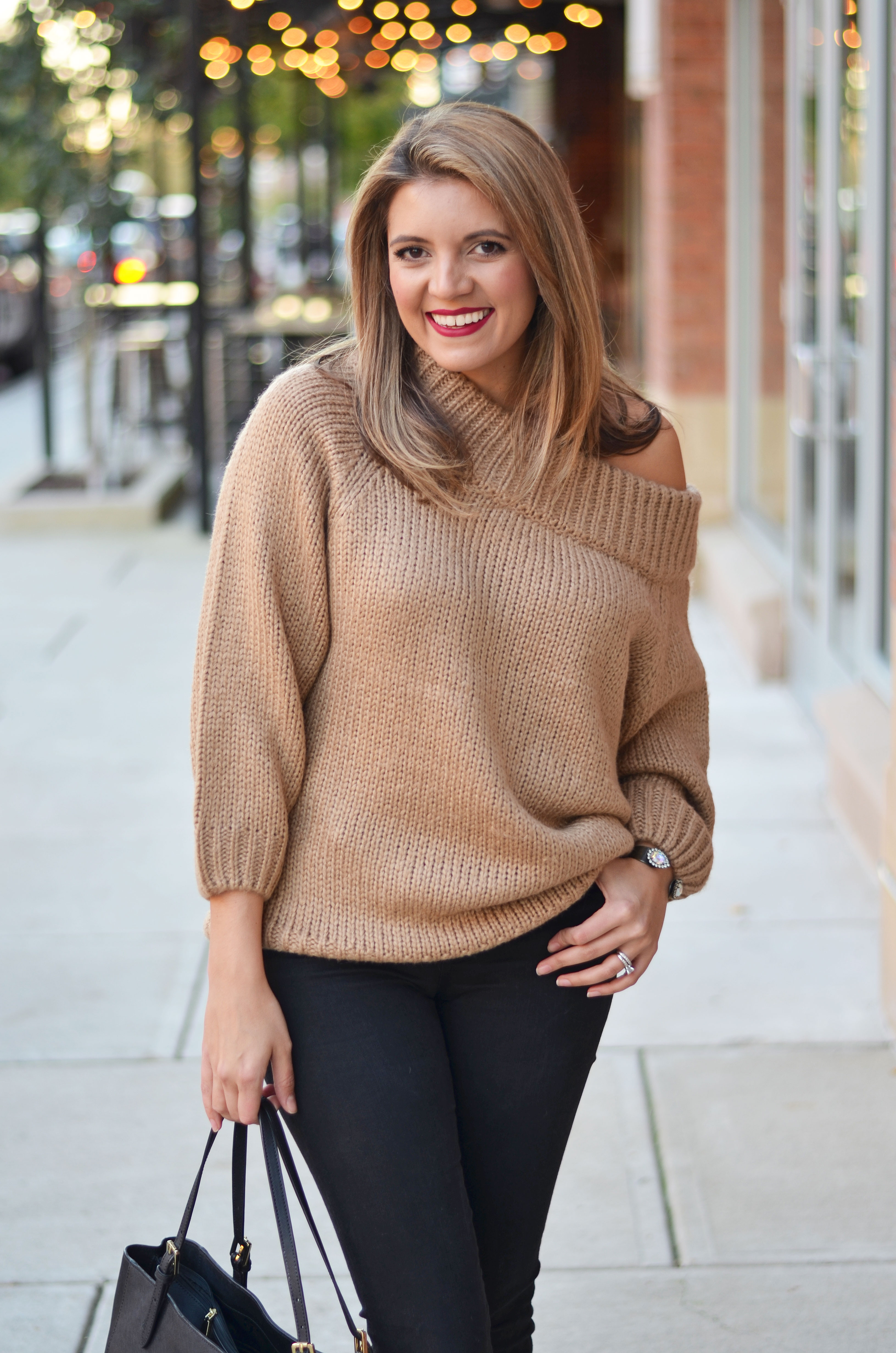black and camel outfit - camel off shoulder sweater with black skinny jeans outfit | www.bylaurenm.com