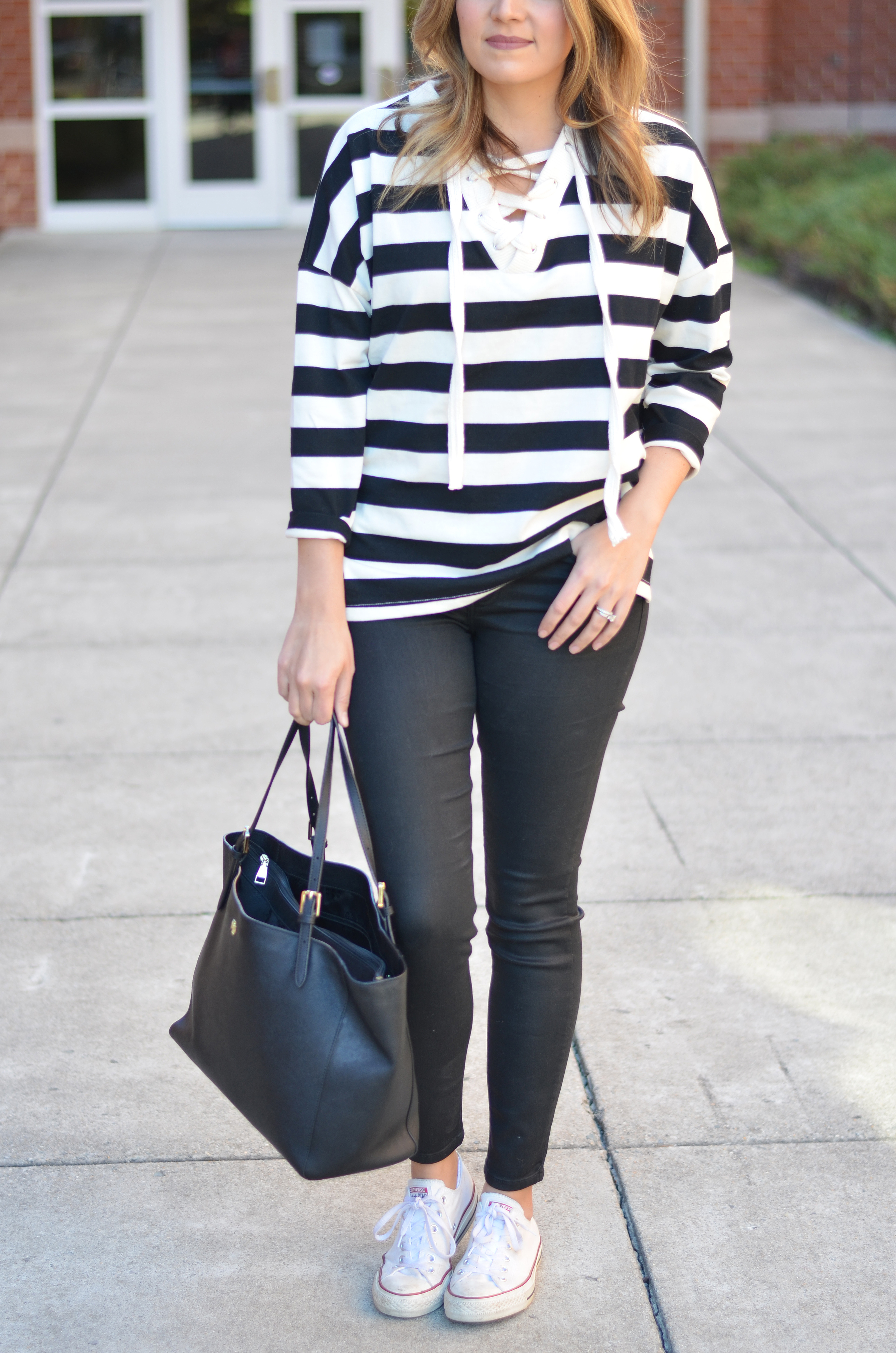 chic weekend outfit - black coated skinny jeans, stripe lace-up top, white converse outfit | www.bylaurenm.com