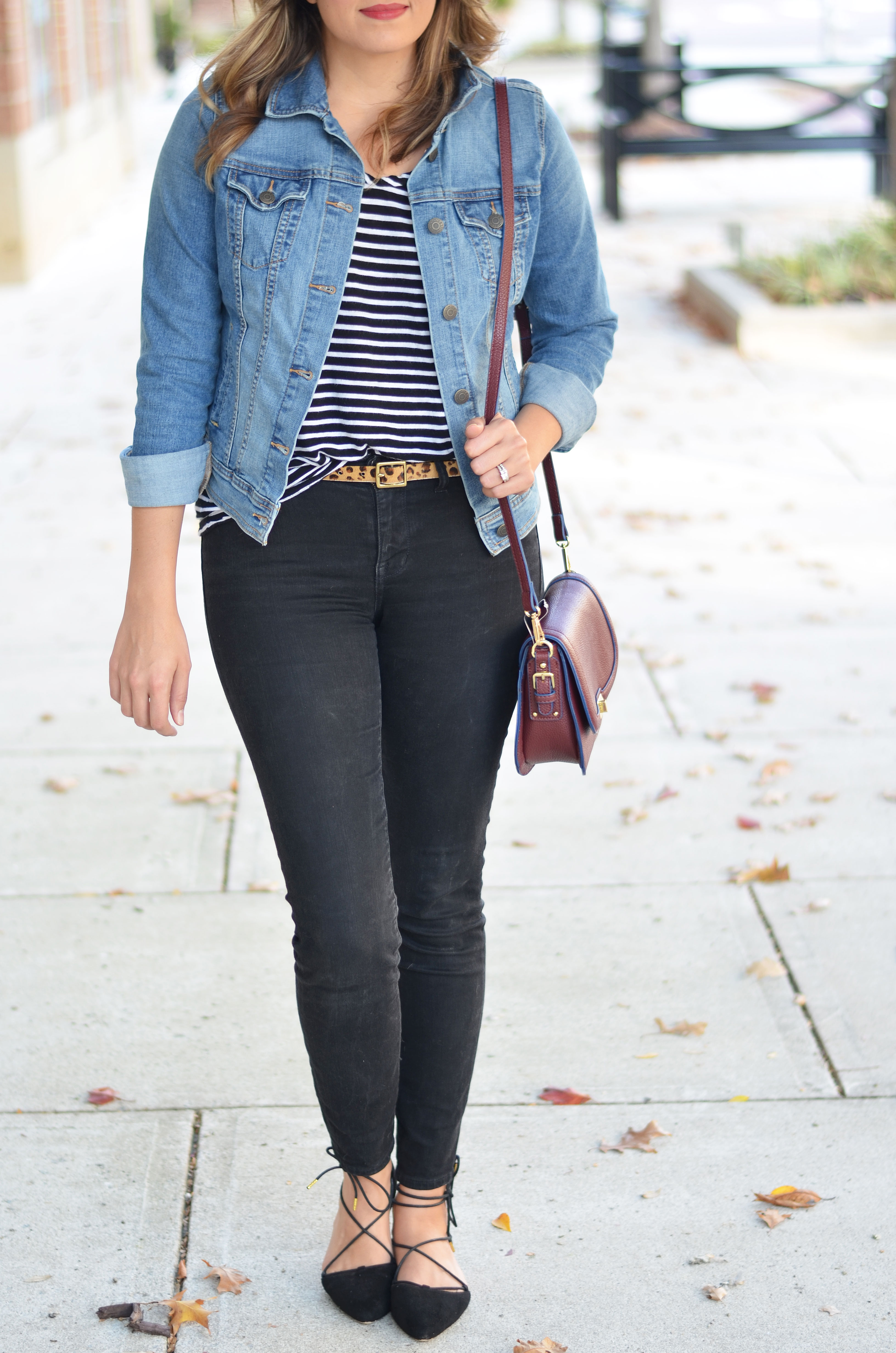 how wear a denim jacket - perfect denim jacket with striped tee, leopard print belt, black jeans, and black lace-up flats | www.bylaurenm.com