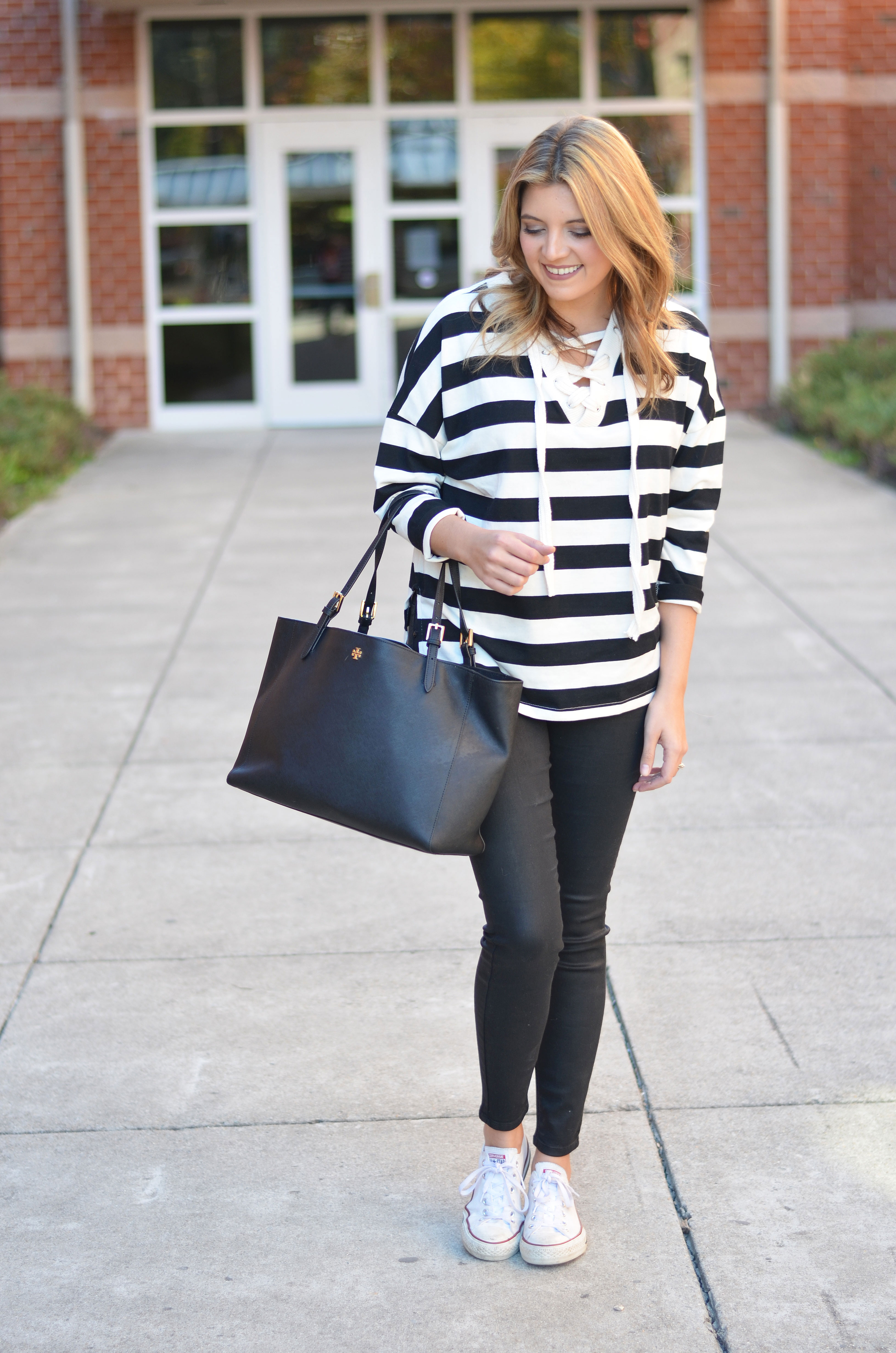 cute weekend outfit - stripe lace up top with black coated jeans outfit | www.bylaurenm.com