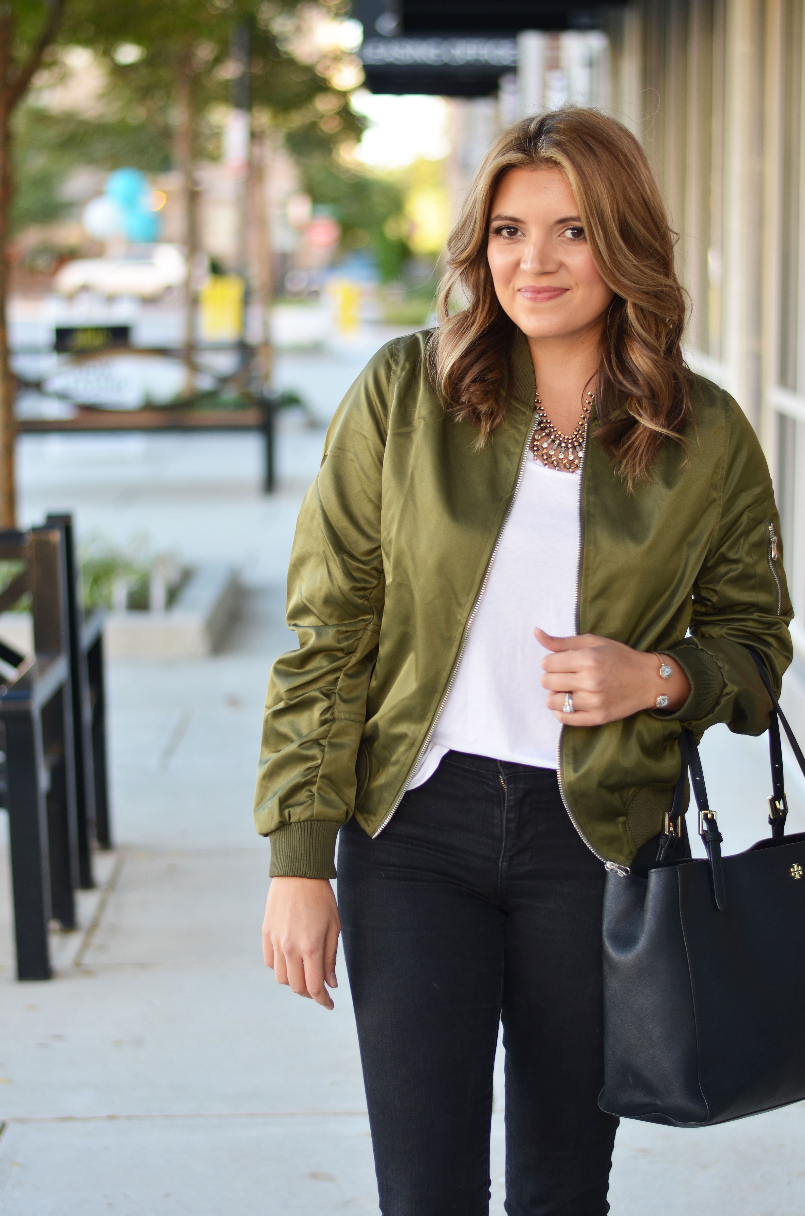 olive satin bomber jacket outfit idea - satin bomber jacket with a white tee and black jeans | www.bylaurenm.com