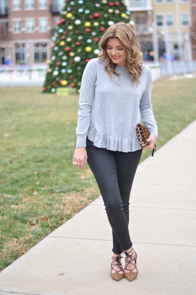 gray ruffle heam sweater and black coated jeans with cheetah print accessories | www.bylaurenm.com