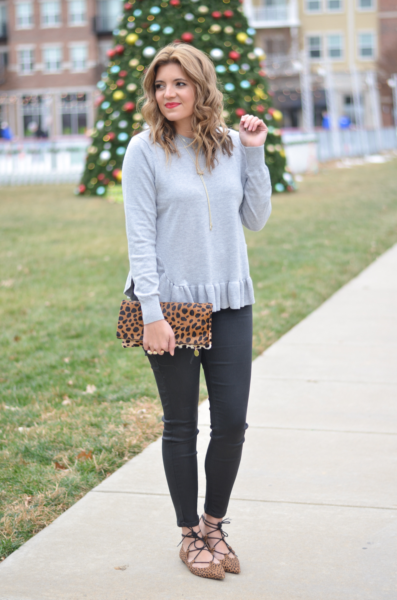 gray ruffle hem sweater with black coated jeans | www.bylaurenm.com