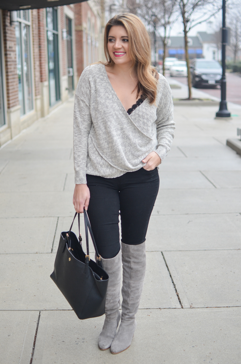 draped gray sweater with black lace bralette, black jeans, and gray boots - Click through for more chic Winter outfits or to shop the look! www.bylaurenm.com