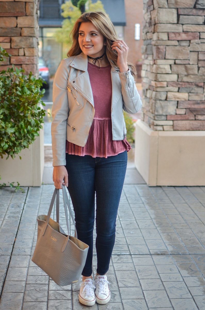 peplum top outfit - red peplum tee with gray leather moto jacket, high waist skinny jeans, and converse sneakers. Click through to see more cute casual outfits or to shop this look! | www.bylaurenm.com