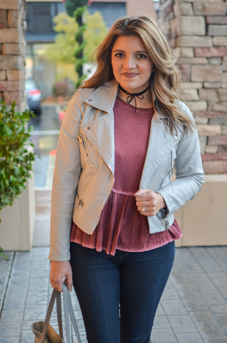 leather moto jacket with red peplum tee and a black choker. Click through to see more cute weekend outfits! | www.bylaurenm.com