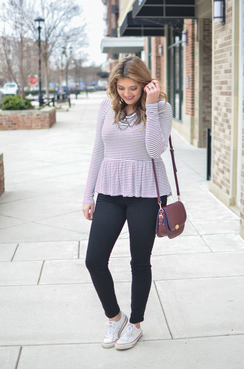 casual weekend outfit - stripe peplum tee, black jeans, and converse. For more cute weekend outfits or to shop this post! | www.bylaurenm.com
