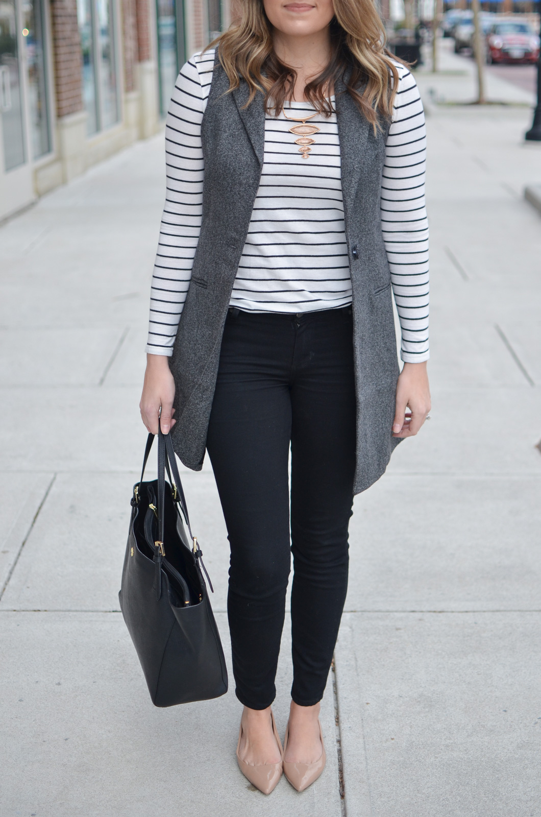 how to wear a long vest - striped tee, long gray vest, black jeans, and nude flats. Want more cute casual outfits? Head to bylaurenm.com!