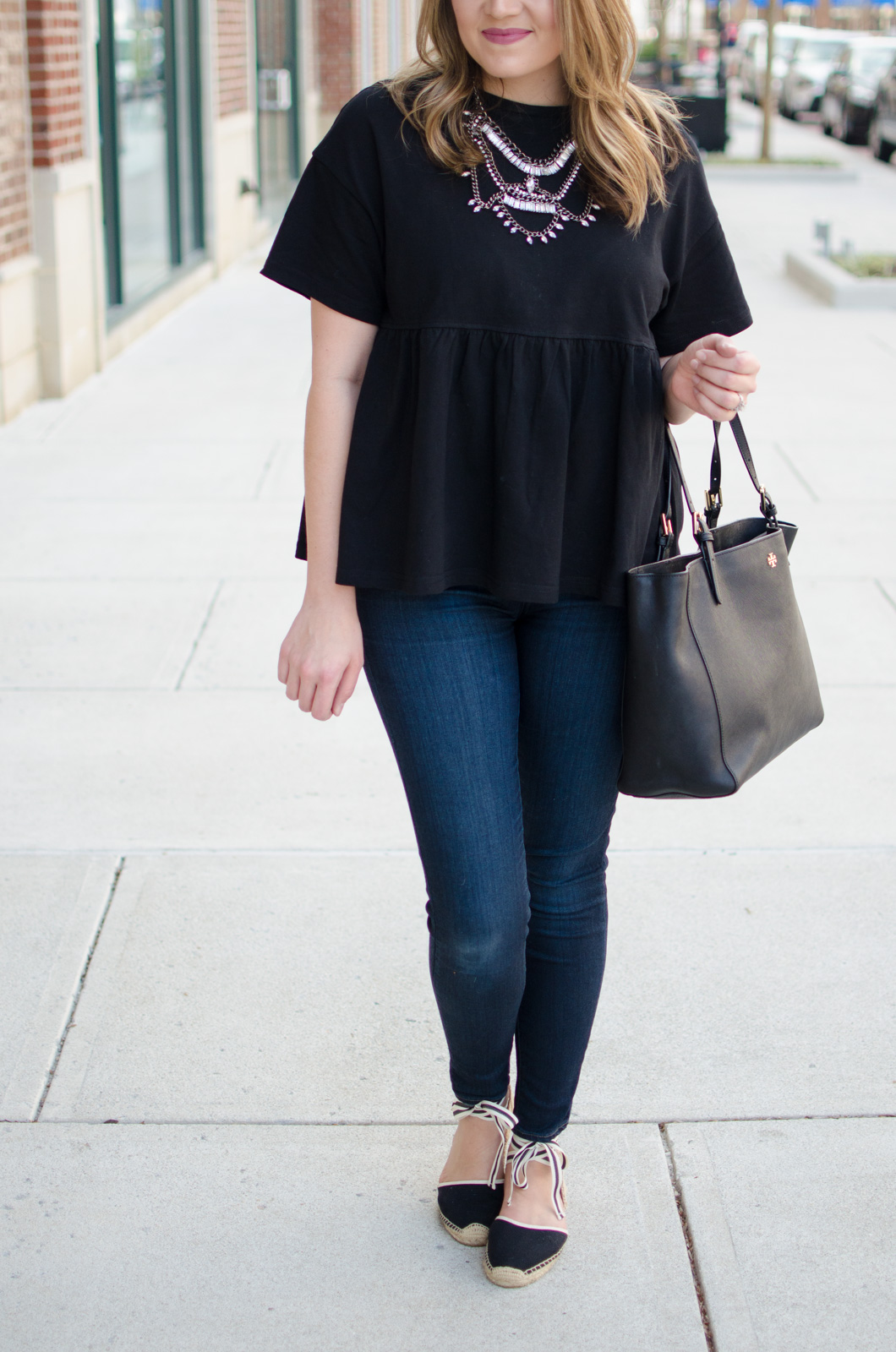 oversized ruffle hem top, high waisted skinny jeans, lace up espadrilles | Click through for more cute weekend outfit ideas or to shop this look! www.bylaurenm.com