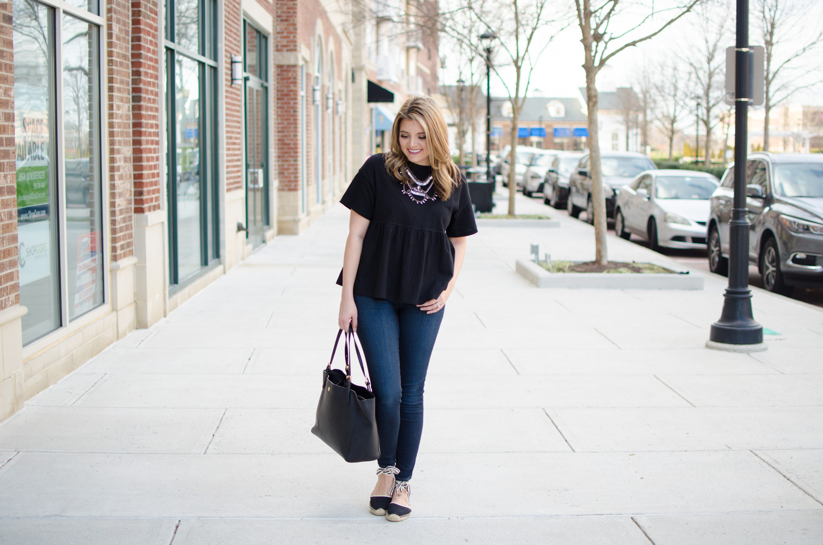 oversized ruffle hem tee, skinny jeans, and lace-up espadrilles | Click through for more cute weekend outfit ideas or to shop this look! www.bylaurenm.com