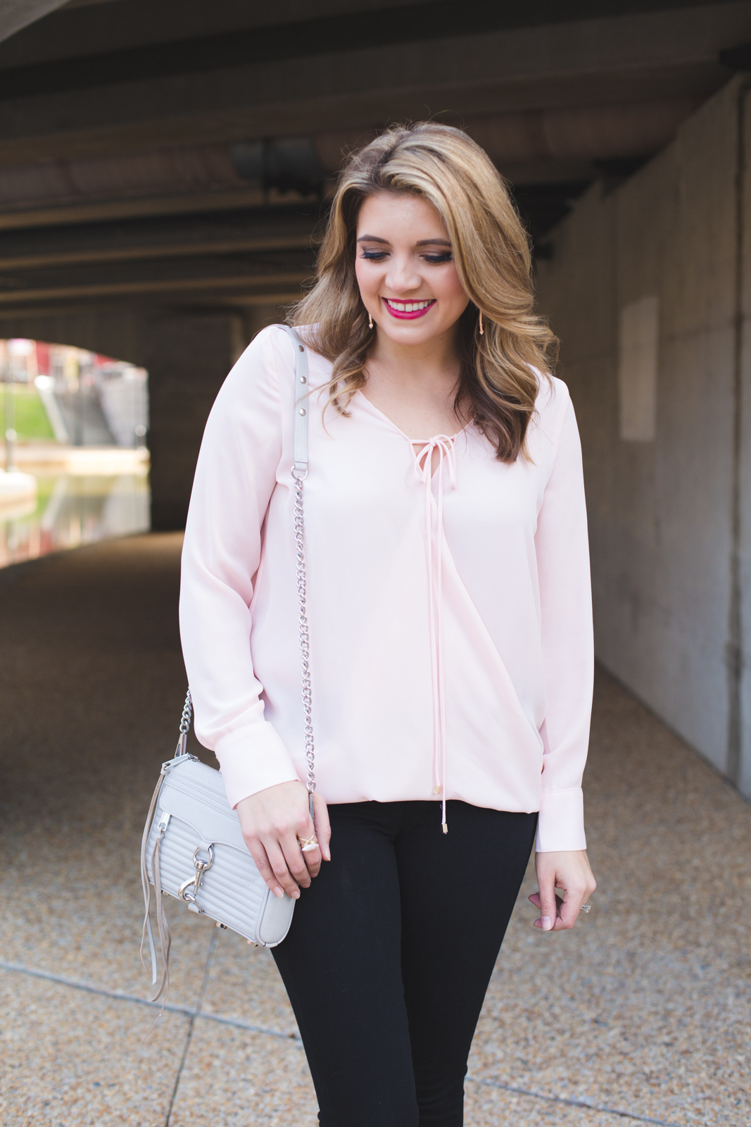 spring work to weekend outfit - blush wrap top with black jeans. | Click through for more Spring outfit inspiration or to shop this look! www.bylaurenm.com