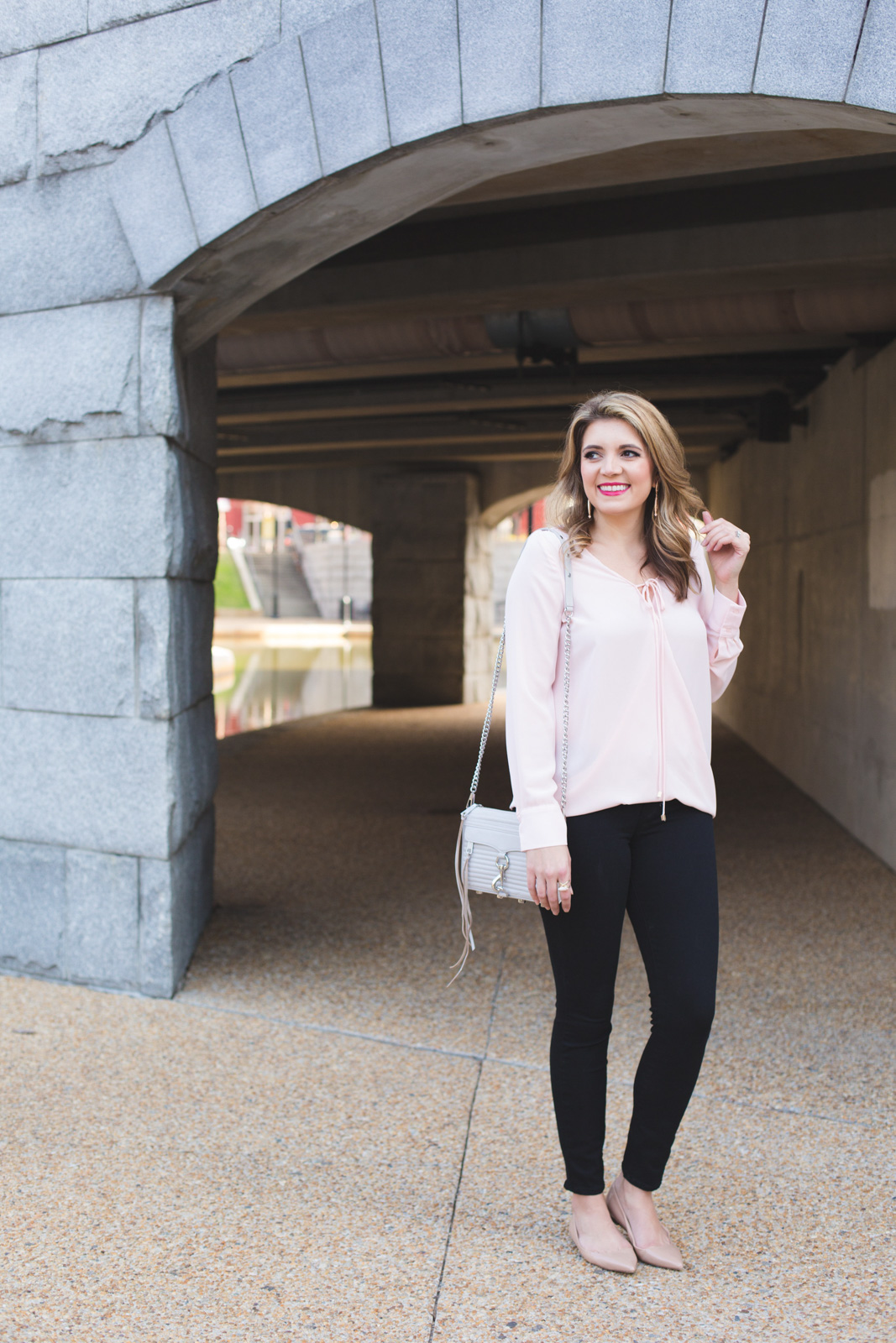 blush pink wrap blouse with black jeans and nude flats. | Click through for more Spring outfit inspiration or to shop this look! www.bylaurenm.com