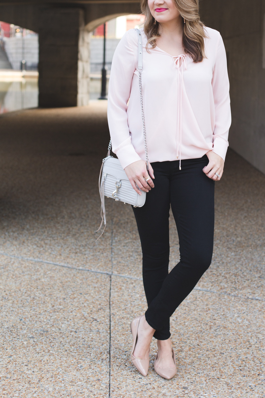 feminine spring outfit - pink wrap front top with black jeans and nude flats. | Click through for more Spring outfit inspiration or to shop this look! www.bylaurenm.com