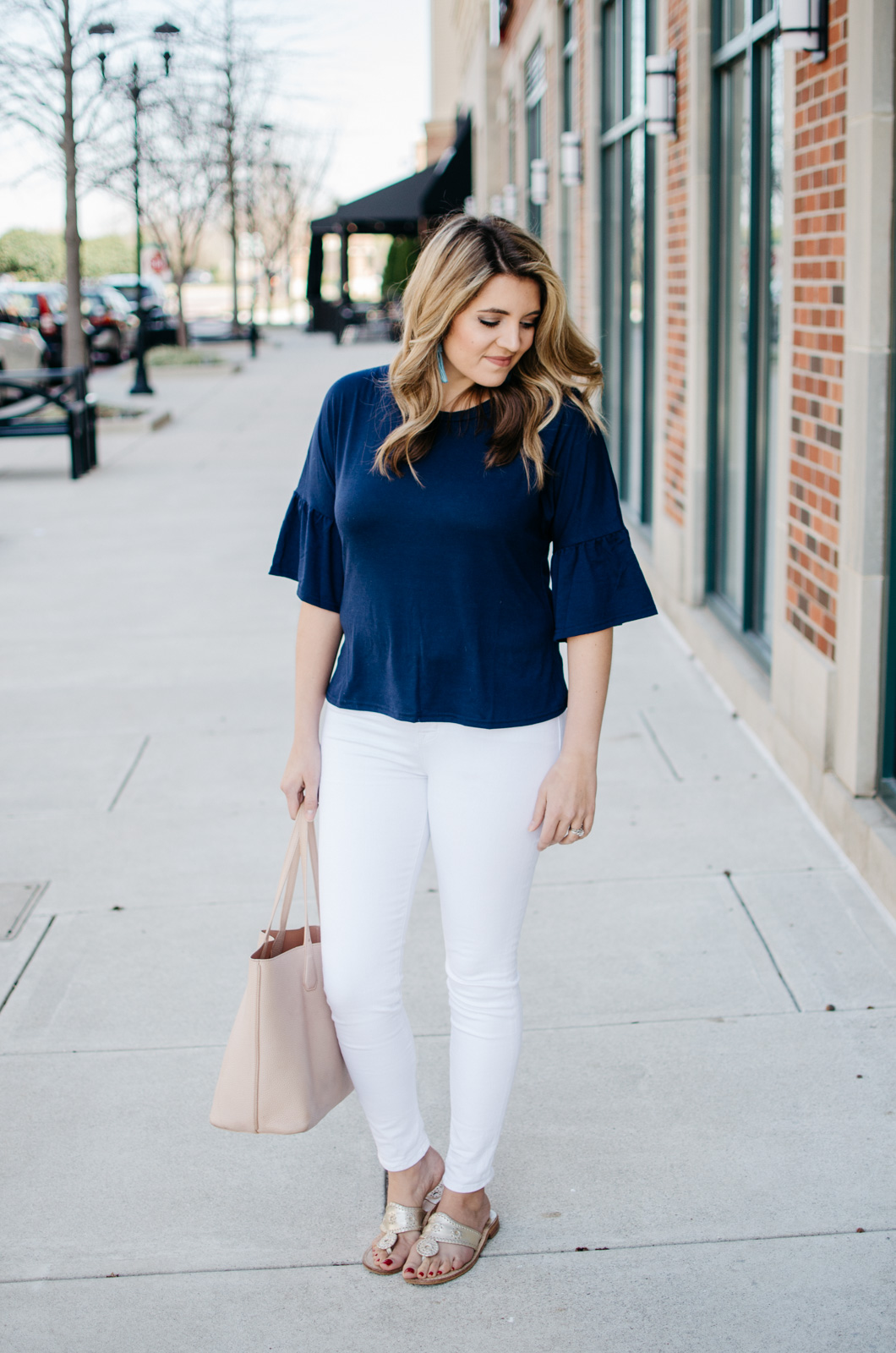 simple spring outfit with bell sleeve tee | Want more cute spring outfits? Head to bylaurenm.com!