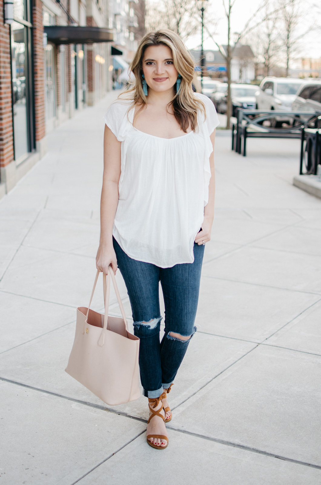 spring outfit ideas - white flutter sleeve top with ruffles | Click through for more spring outfit ideas or to shop the look! www.bylaurenm.com