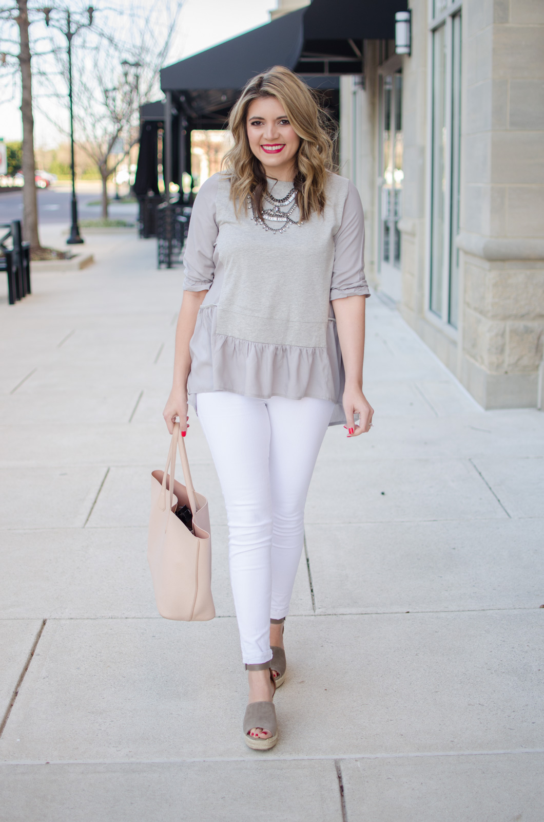 early spring outfit idea - gray ruffle tee with white jeans outfit. Click through for more cute Spring outfits or to shop this look! bylaurenm.com