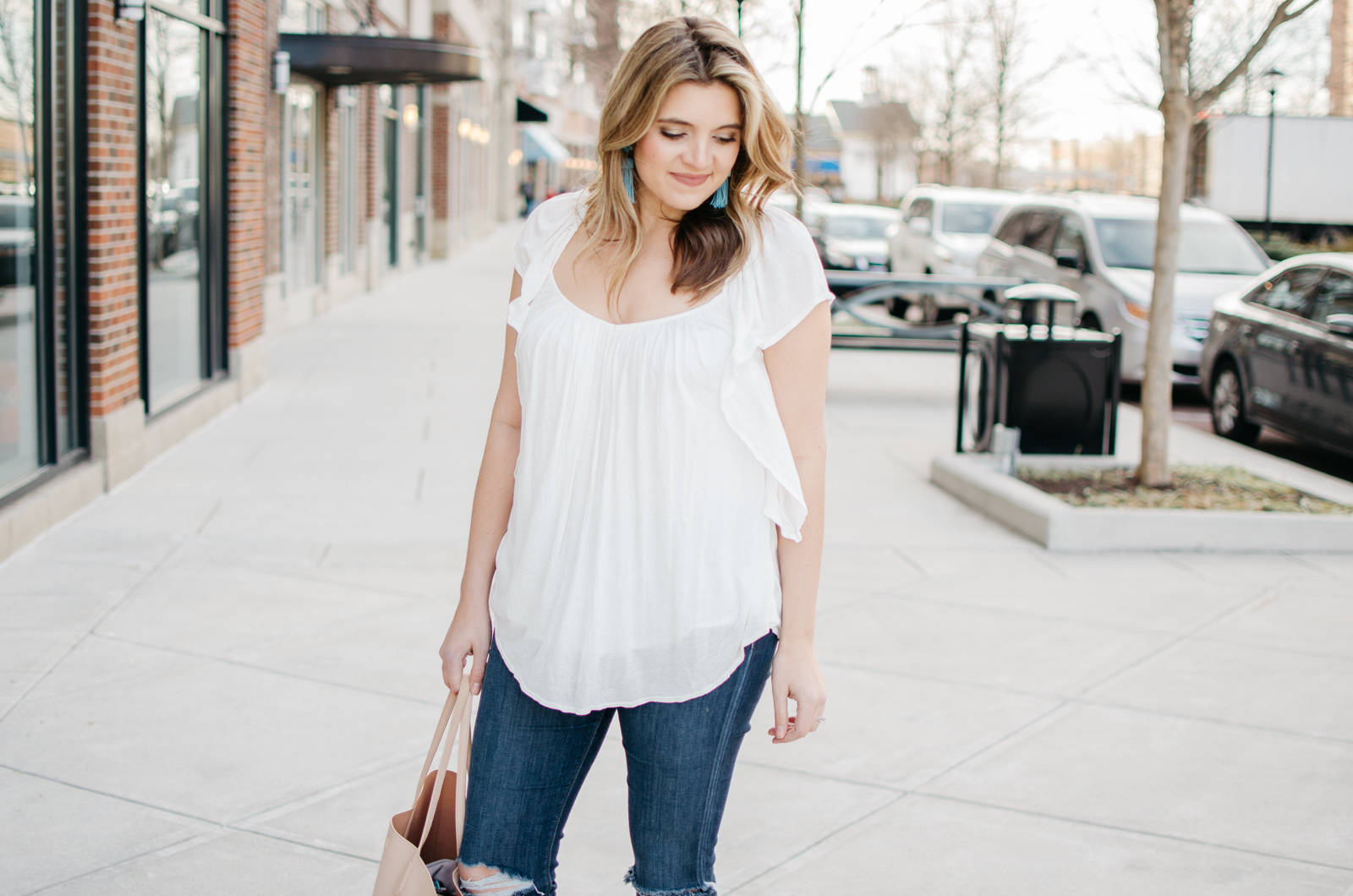 outfit ideas for spring - white ruffle top. | Click through for more spring outfit ideas or to shop the look! www.bylaurenm.com