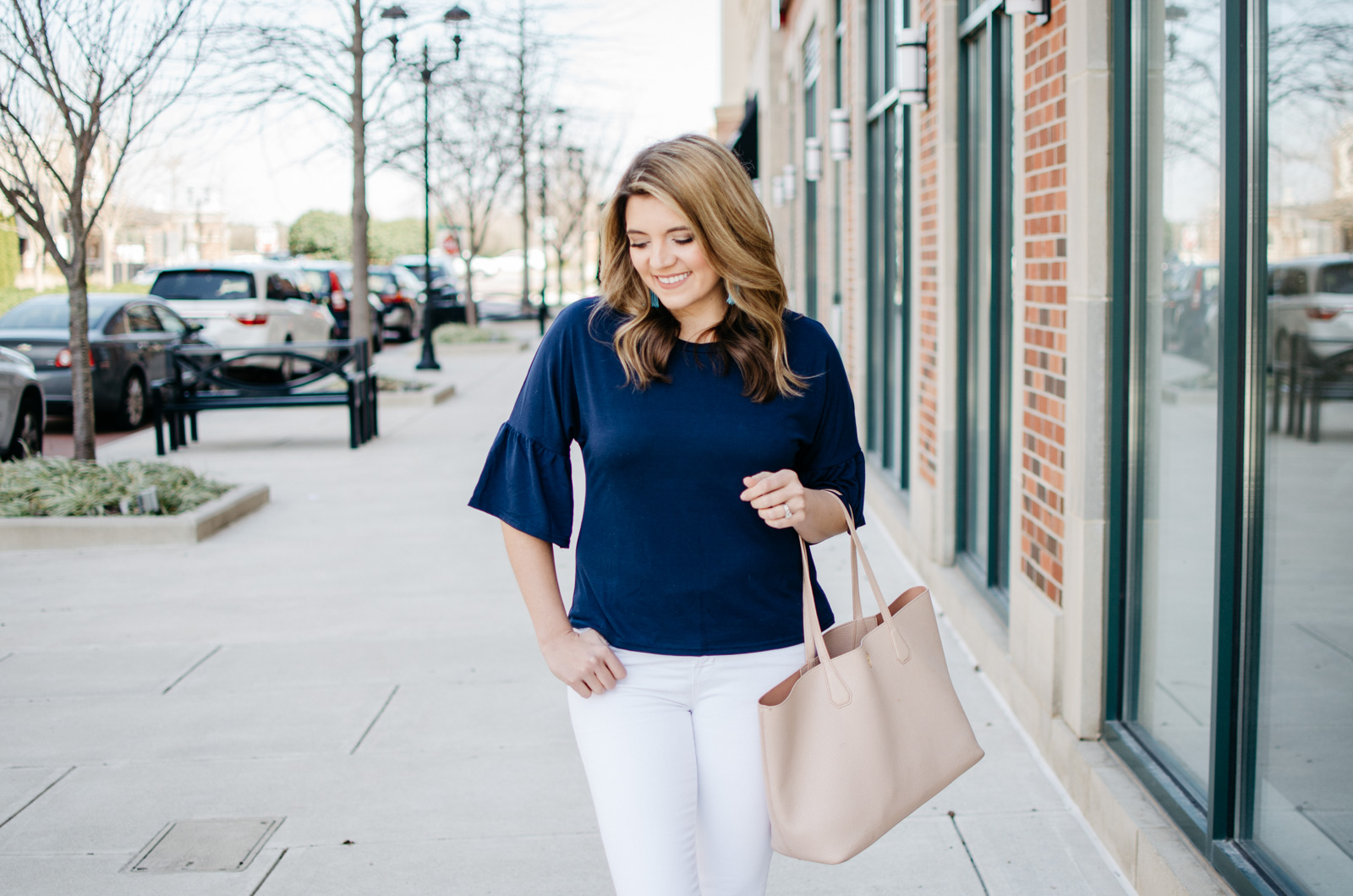 classic spring outfit - bell sleeve tee. Want more cute spring outfits? Head to bylaurenm.com!