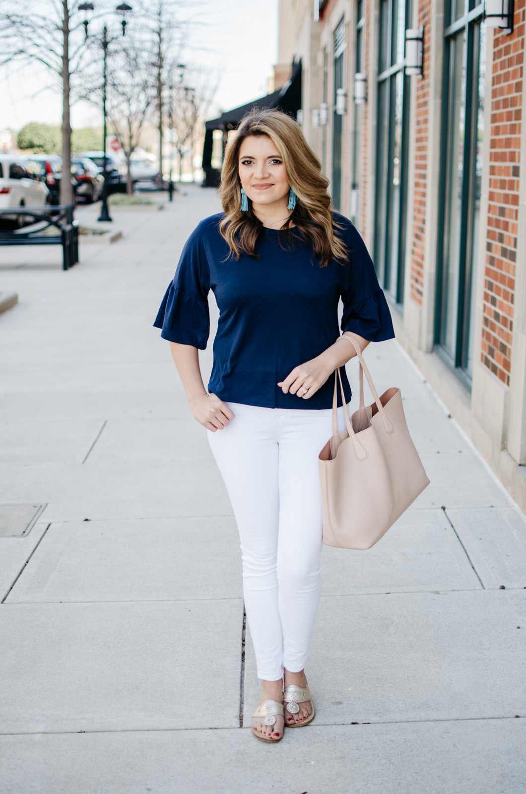 simple spring outfit - bell sleeve tee | Want more cute spring outfits? Head to bylaurenm.com!