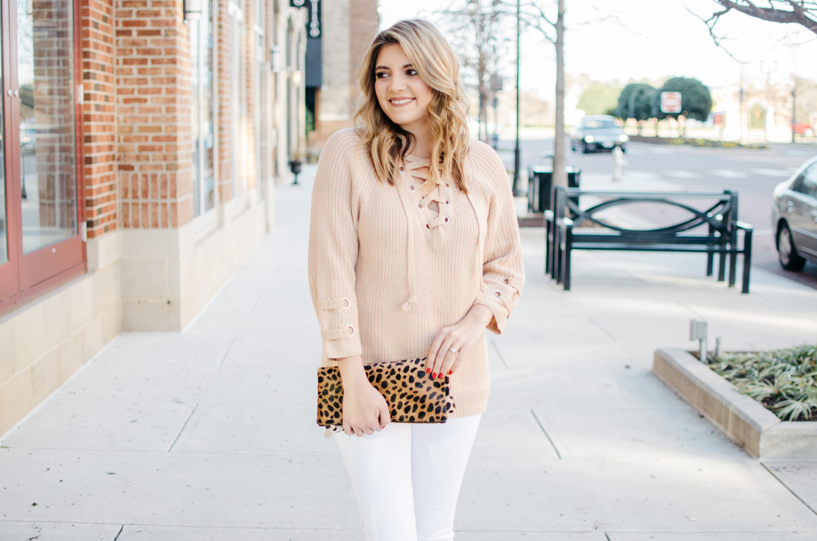 lace up sweater spring outfit - To get more cute Spring outfit ideas or to shop this look, click through to bylaurenm.com!