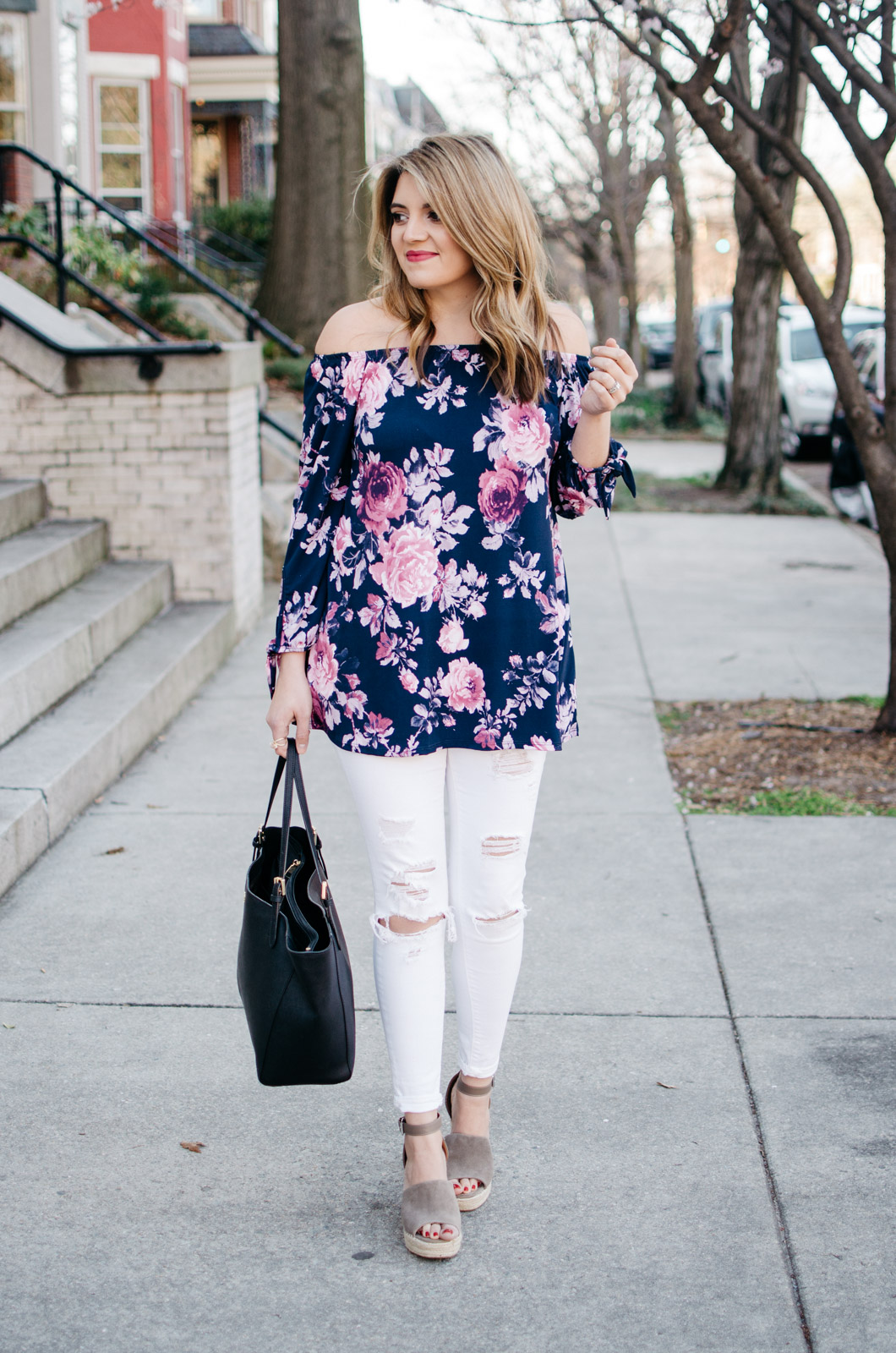 spring outfit idea - off shoulder floral print top and white jeans. For more pretty Spring outfits or to shop this look, head to bylaurenm.com!