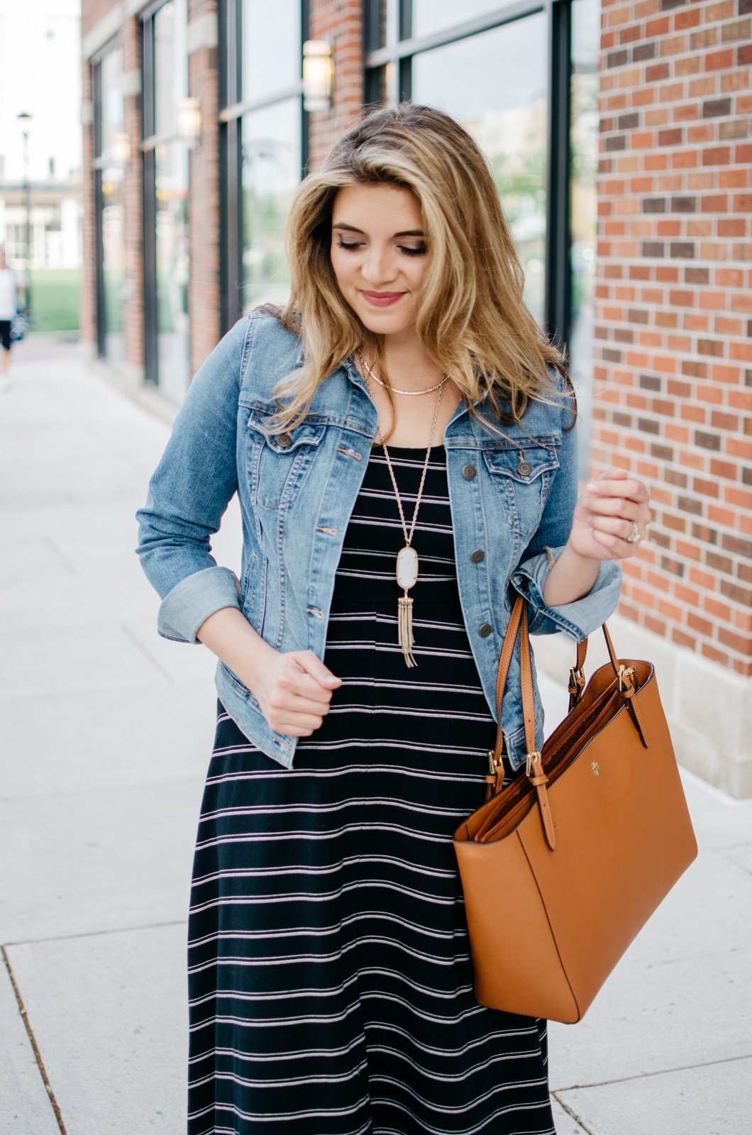 casual spring outfits - striped midi dress + denim jacket outfit | For more Spring outfit ideas, head to bylaurenm.com!