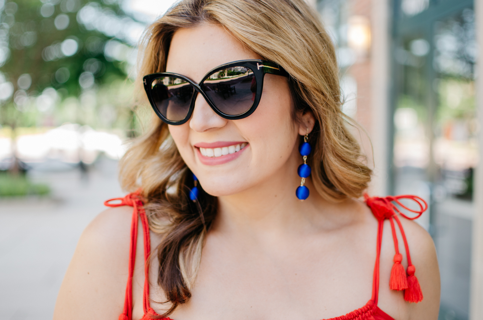 red, white, and blue summer - tassel tank + ball drop earrings | For more cute summer outfit ideas, head to bylaurenm.com!