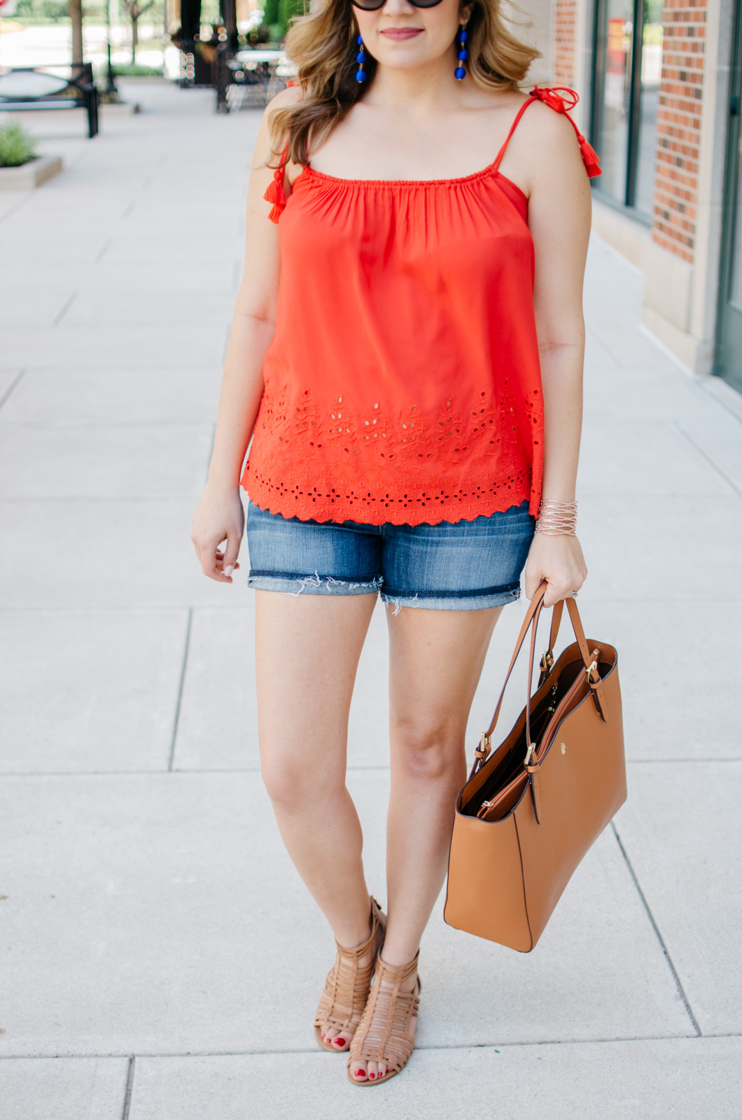 second trimester summer outfit - tassel tank and cutoffs | For more cute maternity outfits, head to bylaurenm.com!