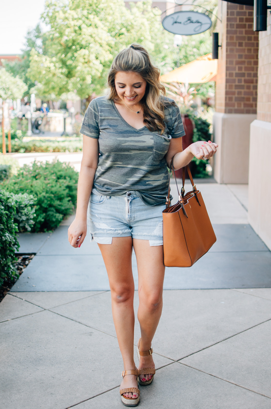 camo tee and cutoffs - cute summer outfit idea | For more summer style ideas, head to bylaurenm.com!