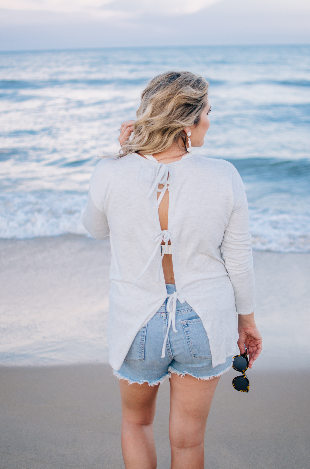 best beach outfits - bow back long sleeve top | For more cute Summer style, see bylaurenm.com