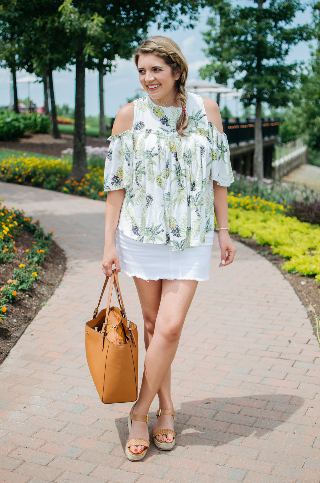 mini skirt outfit - denim mini skirt and pineapple top | For more of the best Summer outfit ideas, head to bylaurenm.com