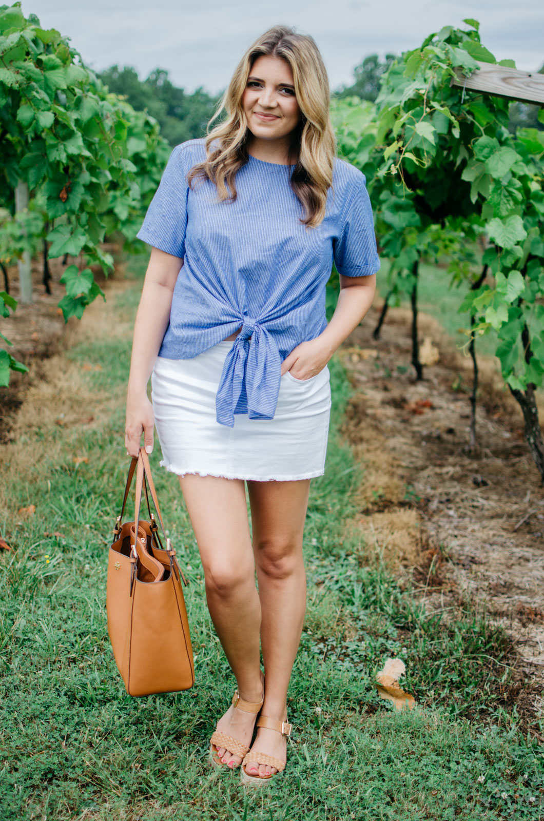 cute summer outfit - tie front top with white denim mini skirt | Want more cute Summer outfits? Head to bylaurenm.com!