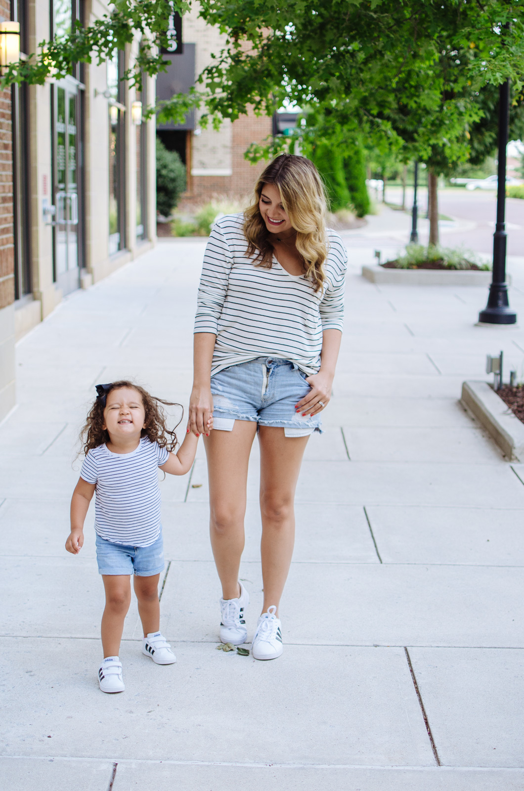 mama daughter outfits - stripes and sneakers | For more mother daughter outfits, head to bylaurenm.com!