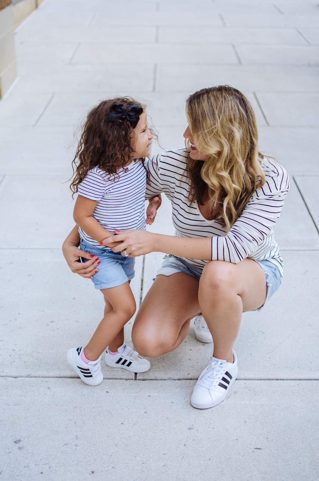 mommy daughter matching outfits - stripes and sneakers | For more mother daughter outfits, head to bylaurenm.com!