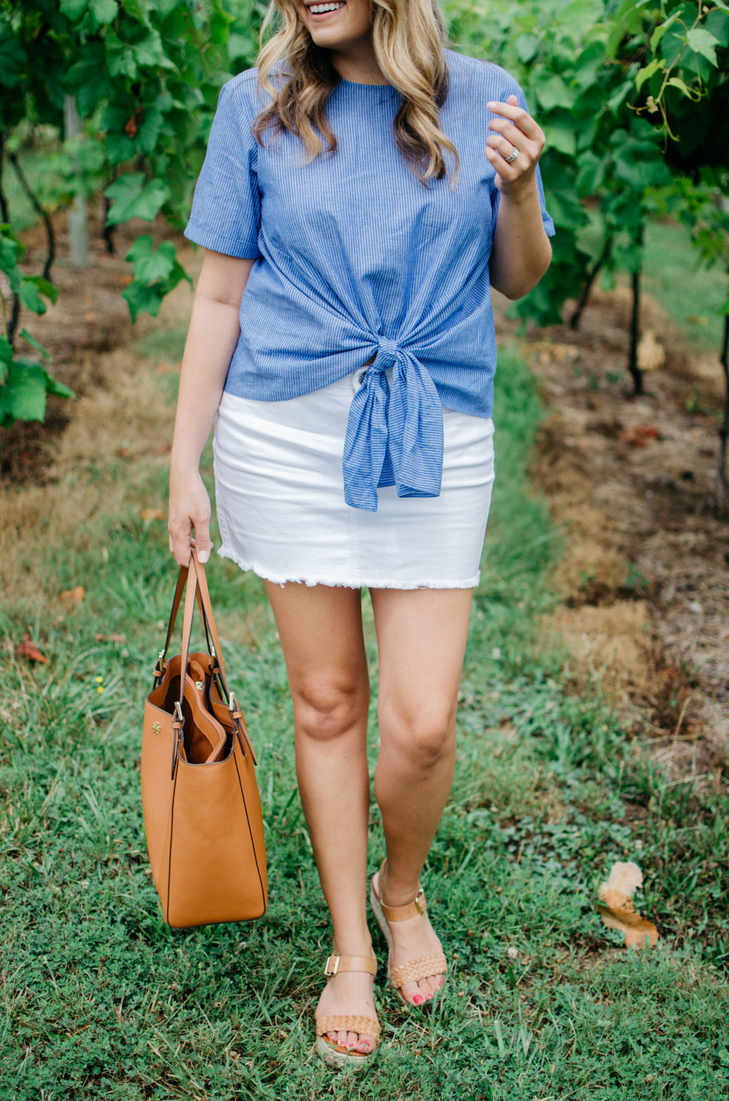 cutest summer style - tie front top and denim mini | Want more cute Summer outfits? Head to bylaurenm.com!