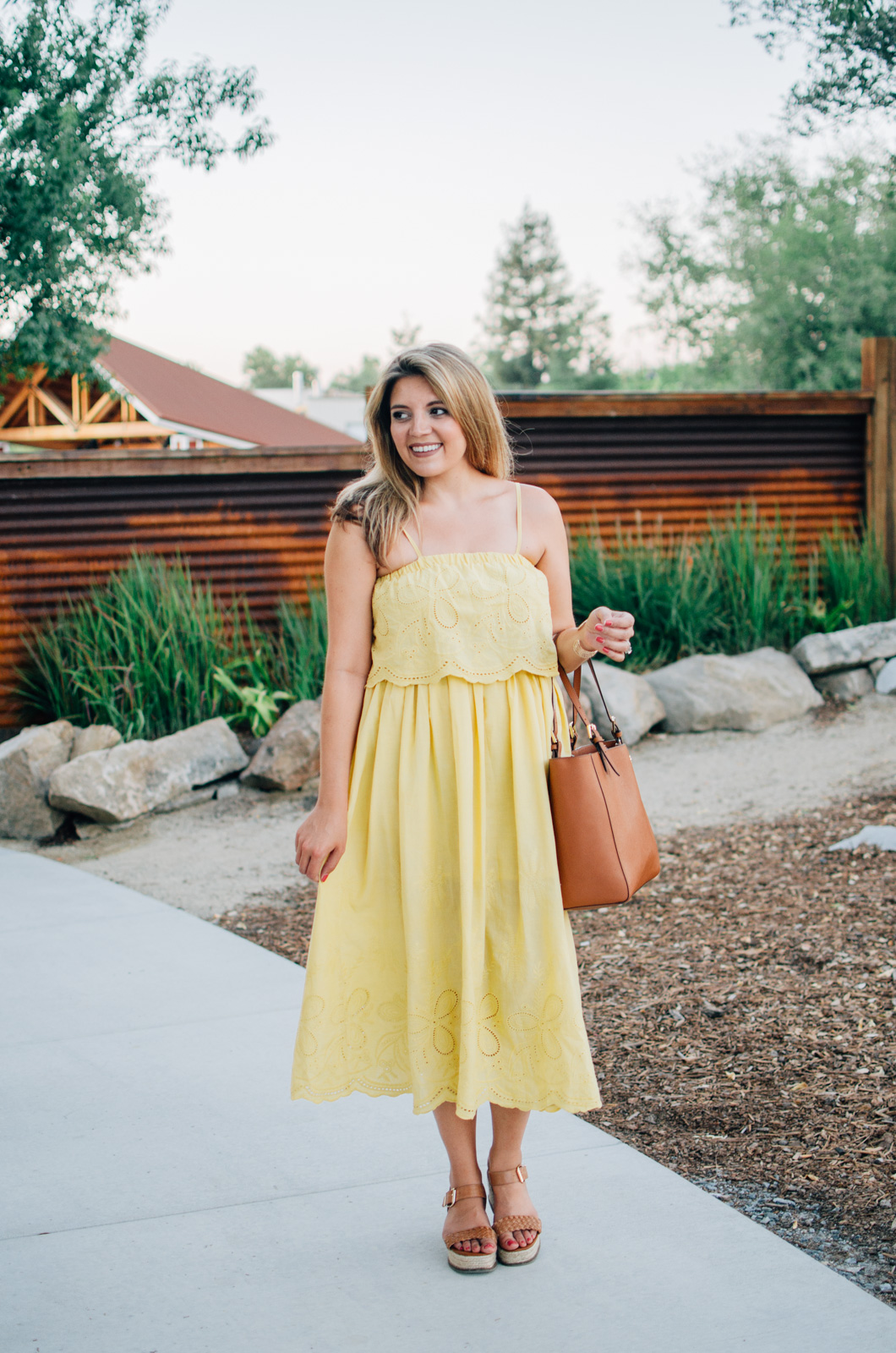yellow midi sundress - cute summer style | More Summer outfit ideas at bylaurenm.com