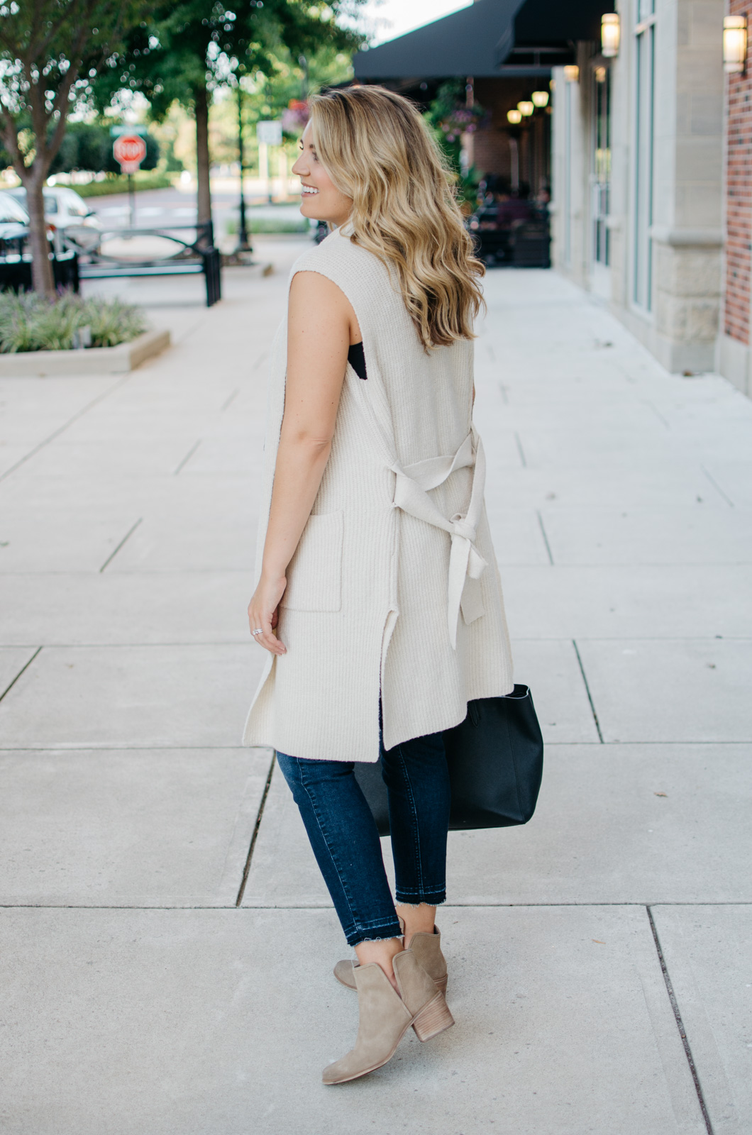 two ways to wear a long sweater vest - sleeveless coatigan outfit | Want to know how to wear a sleeveless sweater? I'm sharing two outfit ideas in today's post! bylaurenm.com