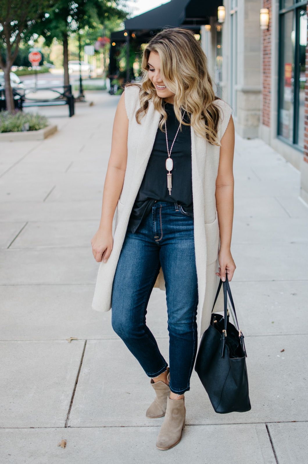 sleeveless sweater vest outfit | Want to know how to wear a sleeveless sweater? I'm sharing two outfit ideas in today's post! bylaurenm.com