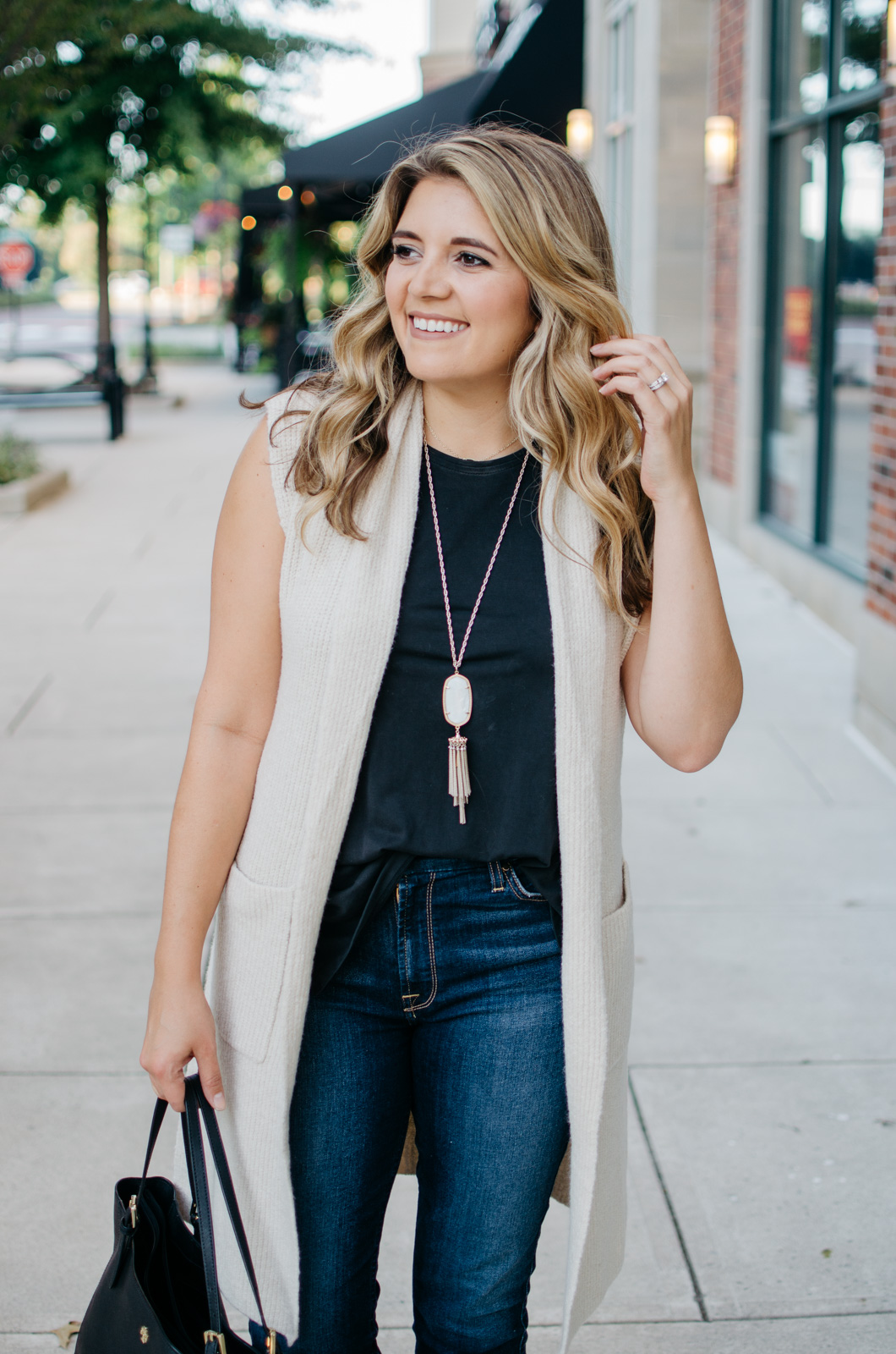 fall transition outfit ideas - long sleeveless sweater | Want to know how to wear a sleeveless sweater? I'm sharing two outfit ideas in today's post! bylaurenm.com