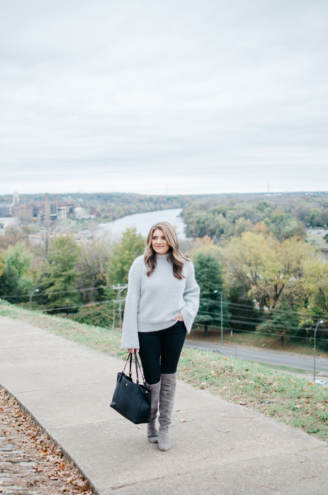 gray and black winter outfit - gray bell sleeve sweater outfit | Get more Winter outfit ideas at bylaurenm.com!